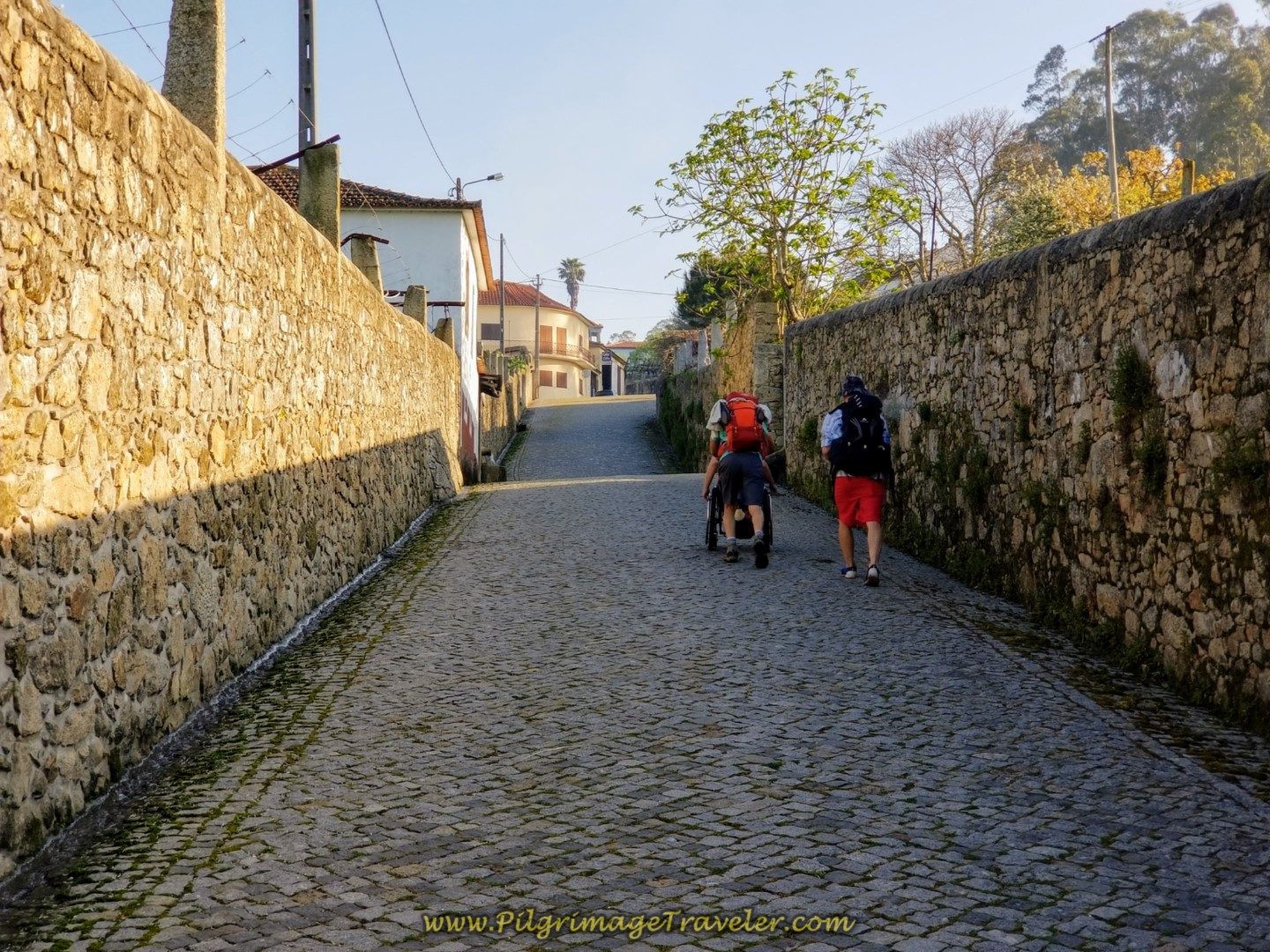 Rich Pushing Magdalena Up the Cobblestone Rua Dom Zameiro, Ponte do Ave, Portugal on the Central Route of the Camino Portugués