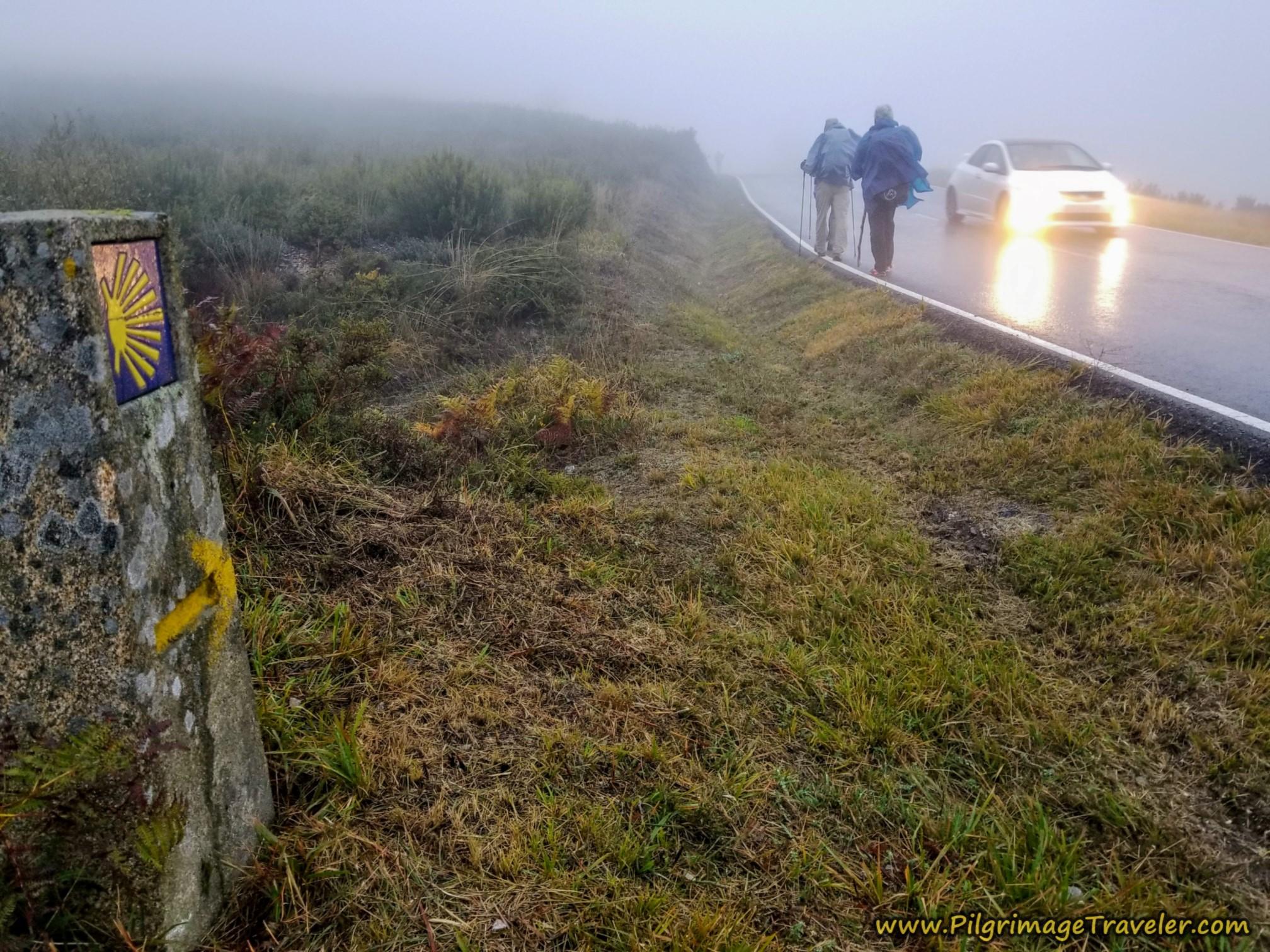 Camino Waymark and Headlights on the Camino Sanabrés from A Gudiña to A Venda da Capela