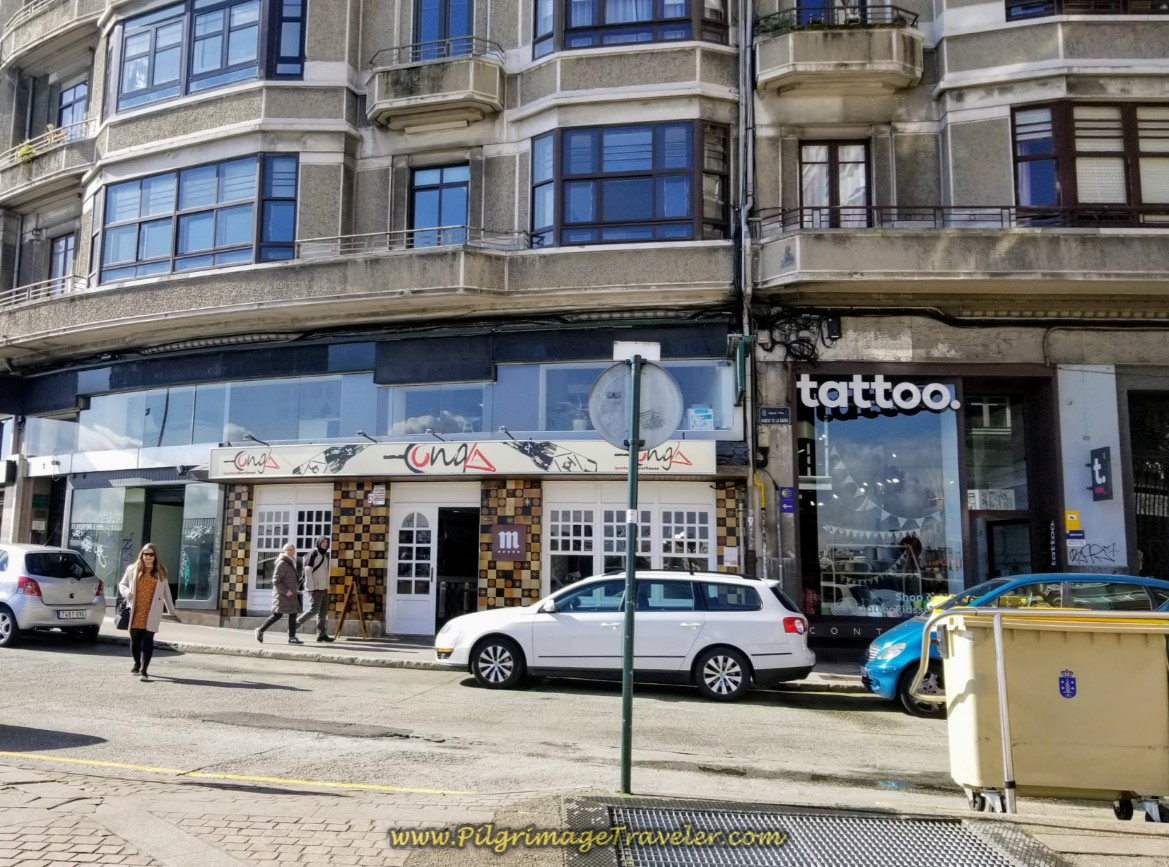 Turn Left at Tattoo Parlor on day one of the La Coruña Arm of the Camino Inglés