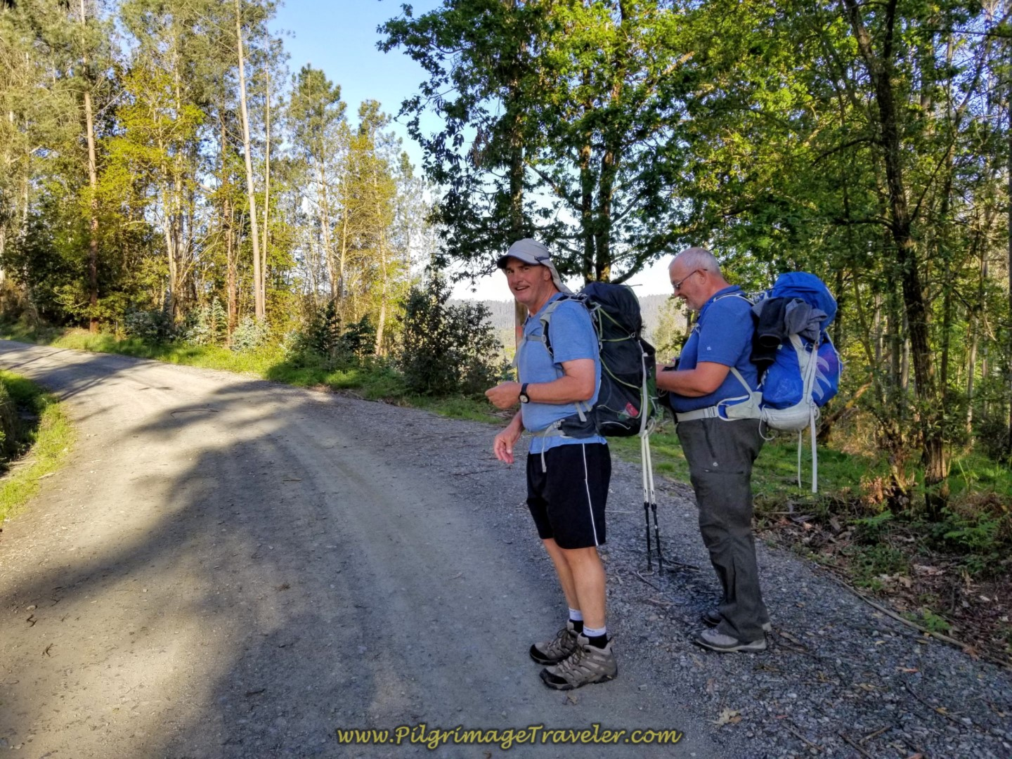 Steve Adjusts Rob's Pack on the Gravel Road on day six of the Camino Inglés