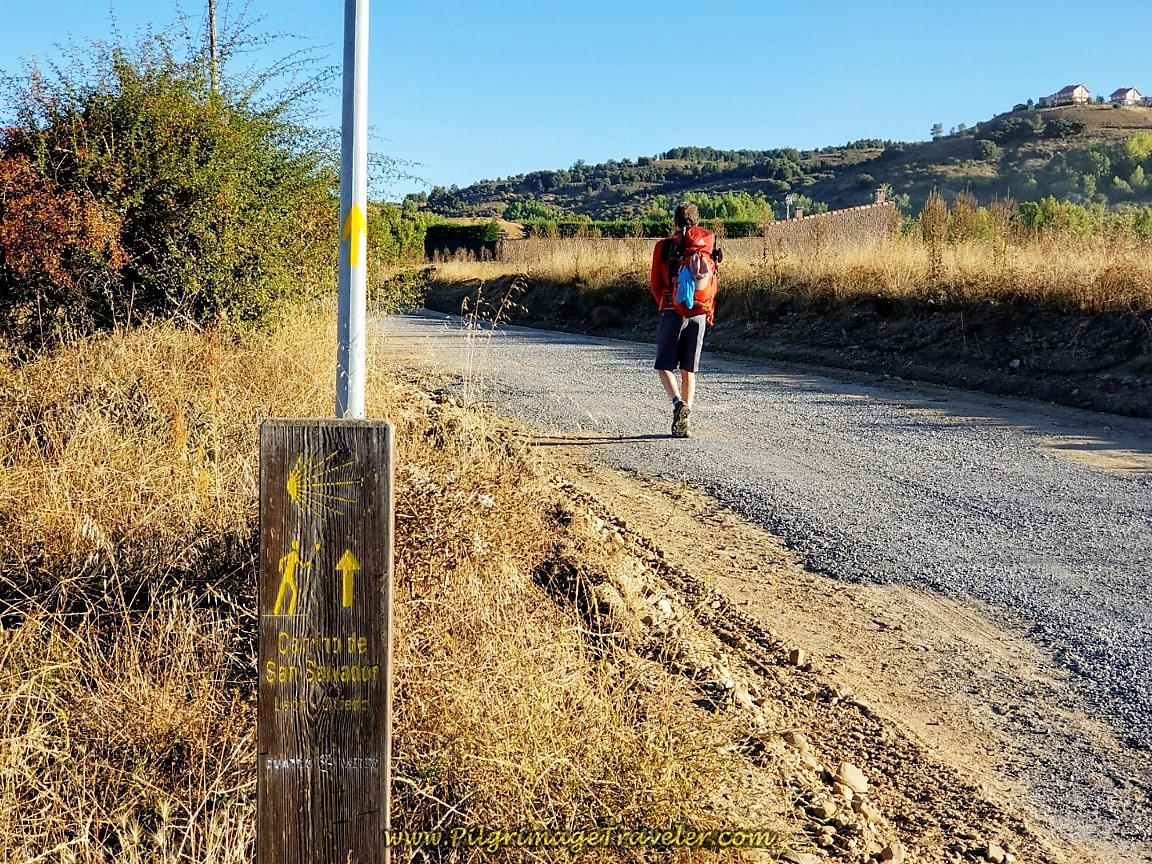 Follow the Wooden Waymarks Onto the Dirt Road