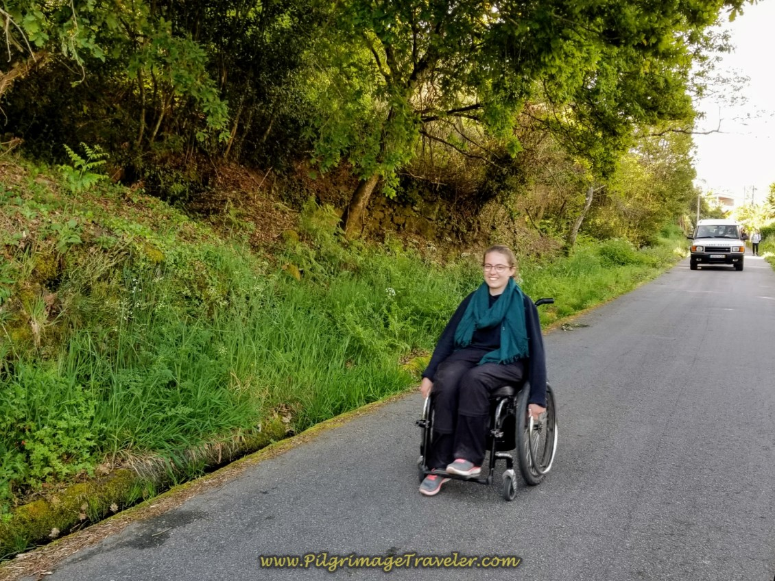 Magdalena Smiles as She Cruises on the Paved Road