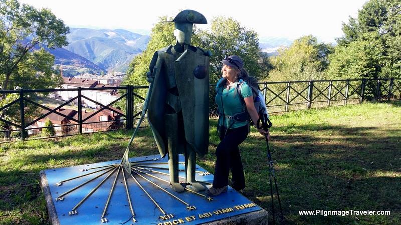 Elle at Sundial Landmark in San Roque on the Camino Primitivo