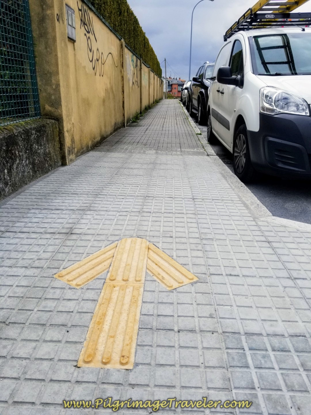 Yellow Arrow on Pavement