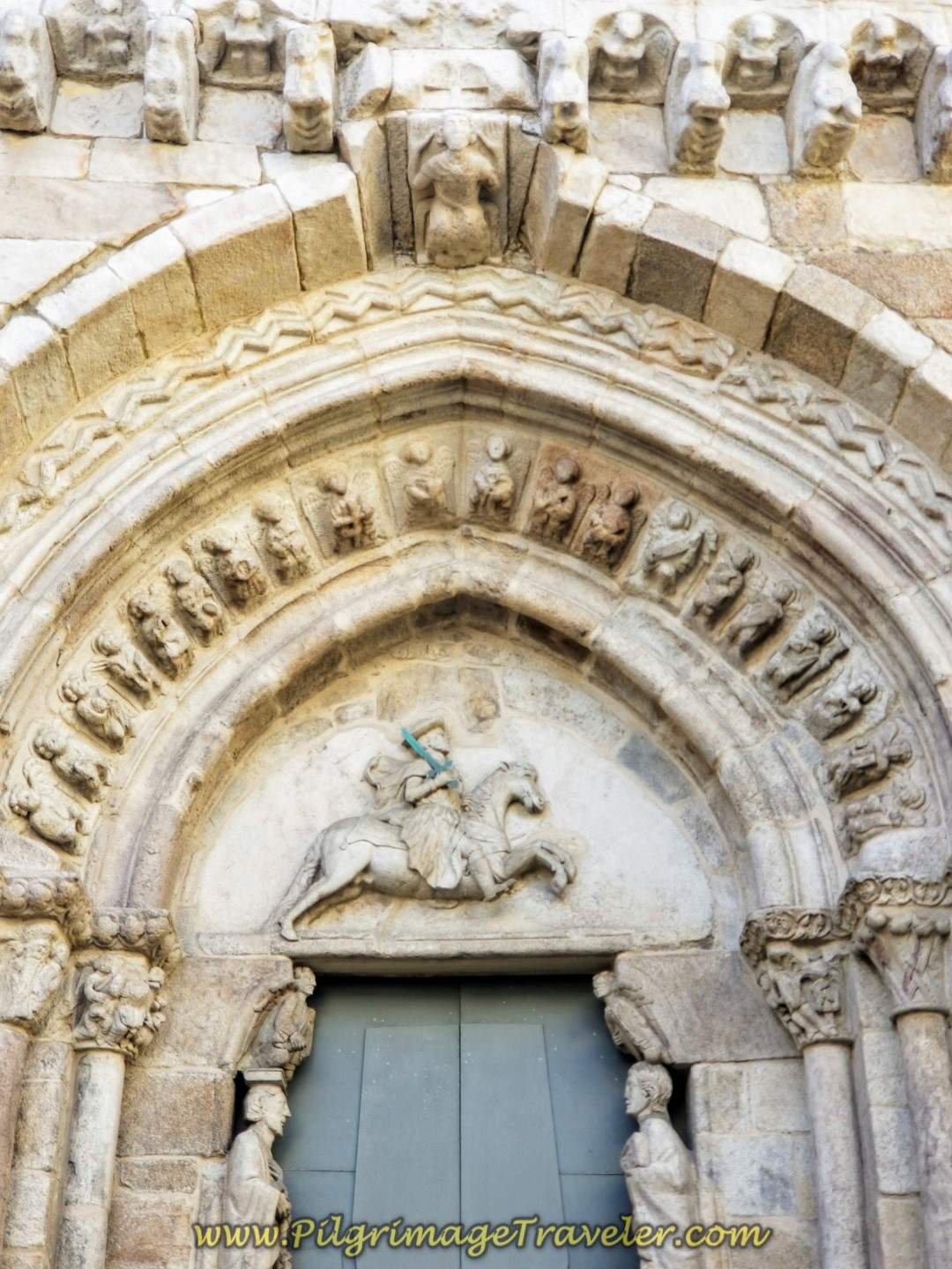 Gothic Portal of the Igrexa de Santiago, depicting the saint as an Equestrian, Santiago Matamoros, on day one of the La Coruña Arm of the Camino Inglés