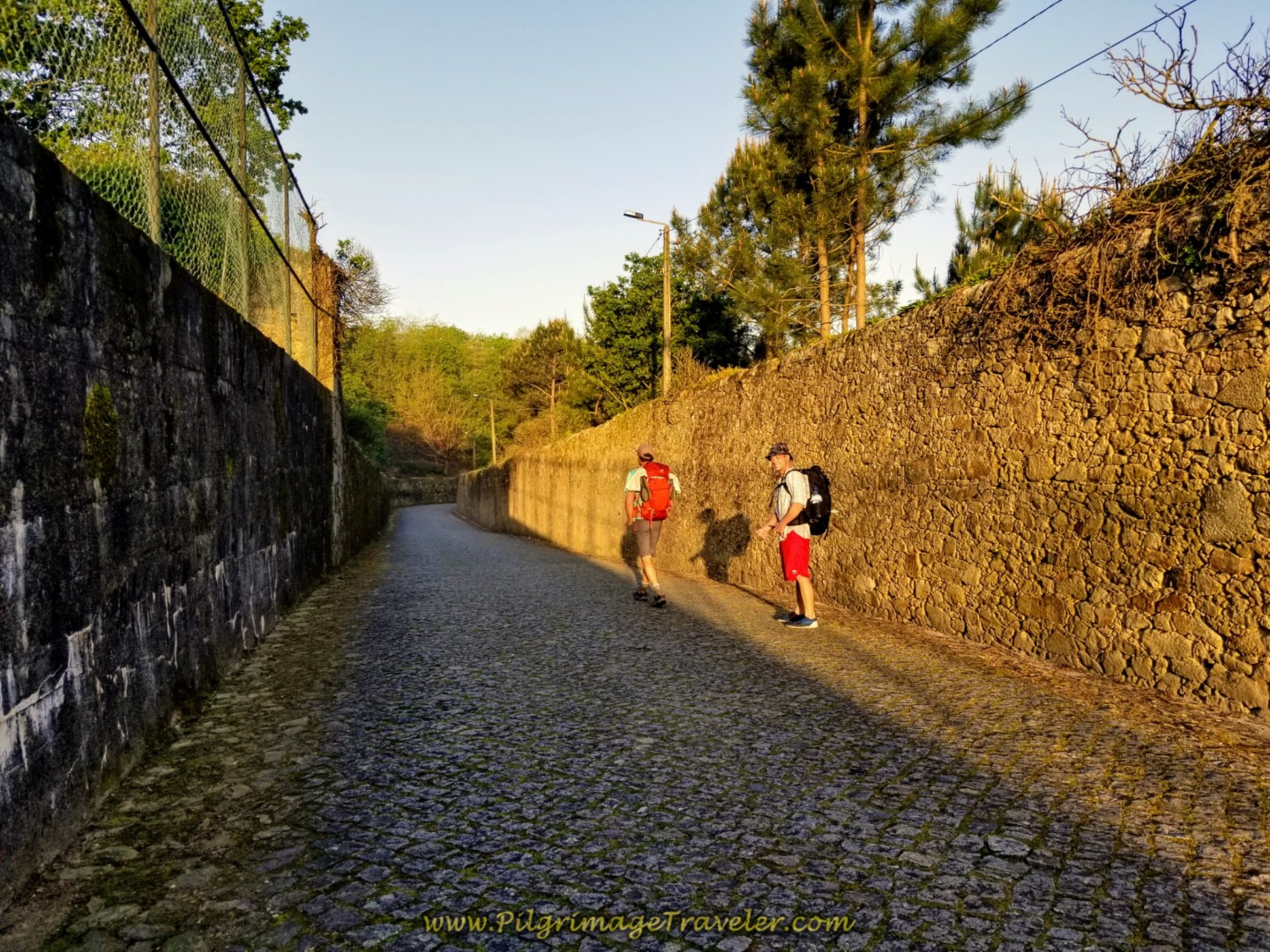 Rich and Matt Setting off on the cobblestone of the Rua de São Bento, in Vilarinho Portugal on the Central Route of the Camino Portugués