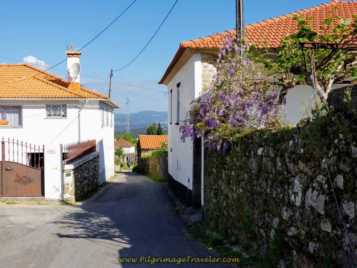 Long, Paved Downhill on the Rua da Pereira on the Road to Fontoura on day nineteen on the Central Route of the Portuguese Camino