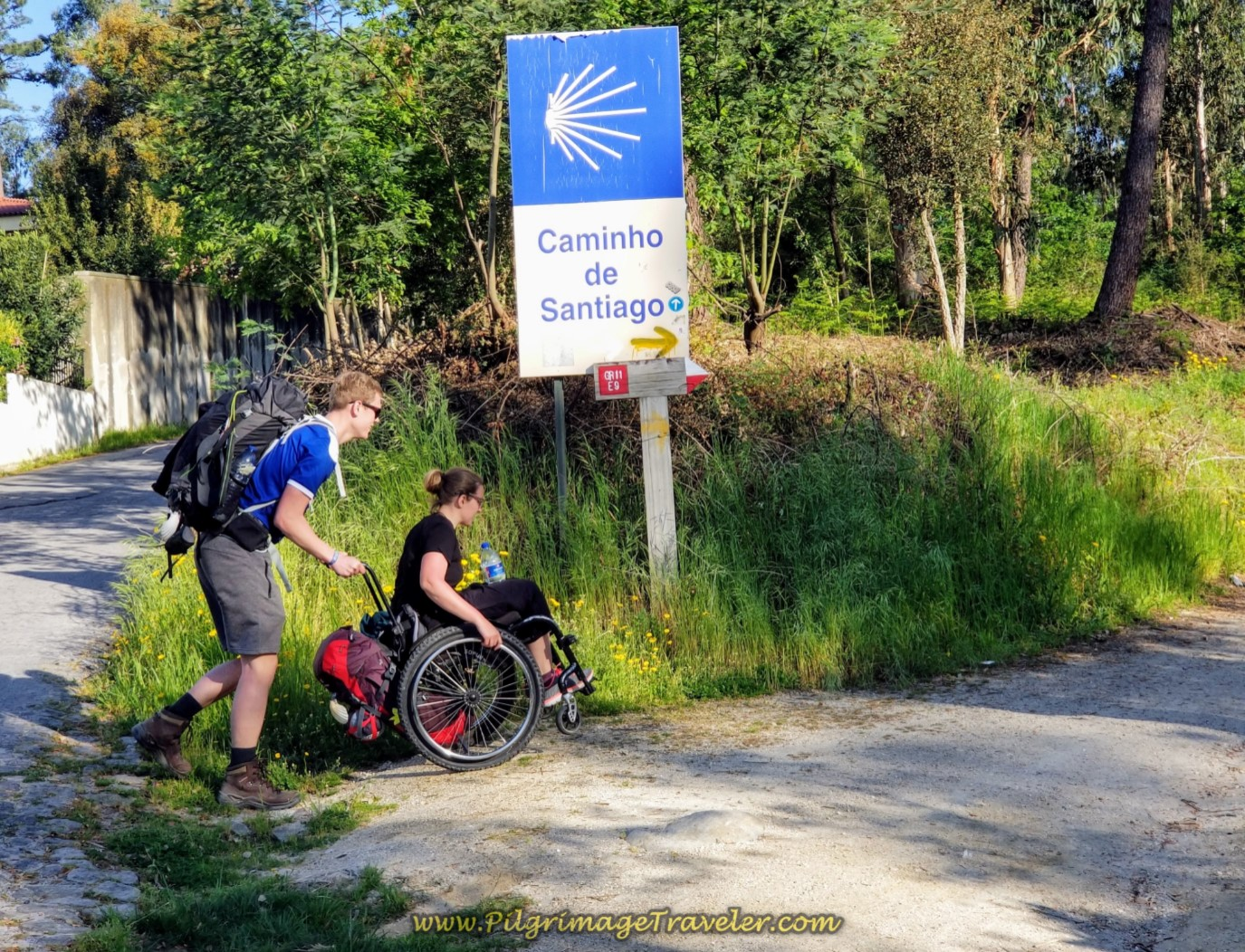 Magnus Pushes Magdalena on the Caminho de Santo Tiago, Lijó, Portugal on day seventeen on the Central Route of the Camino Portugués