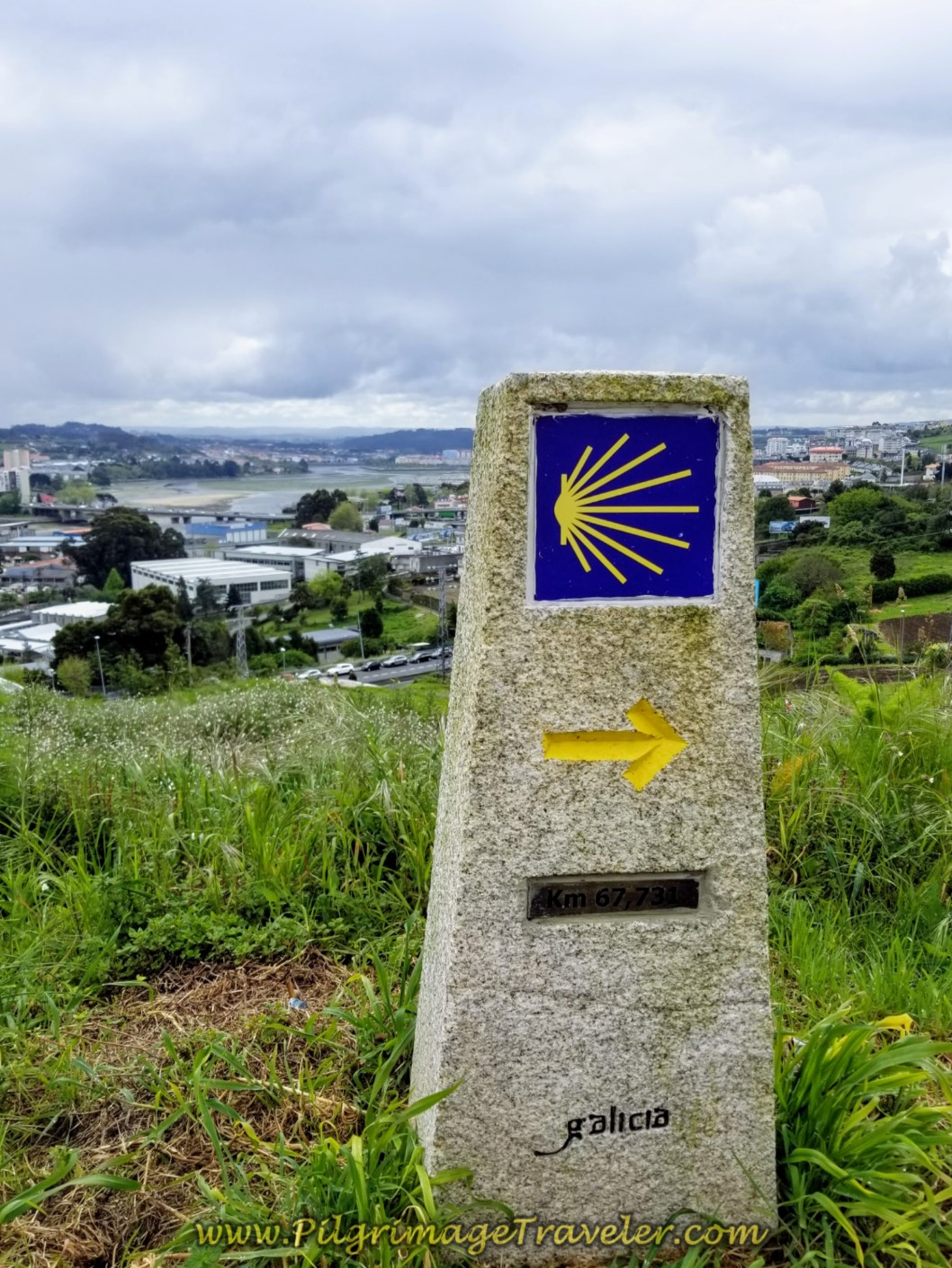 67.7 Kilometer Marker and Ría de Coruña Estuary on day one of the La Coruña Arm of the Camino Inglés