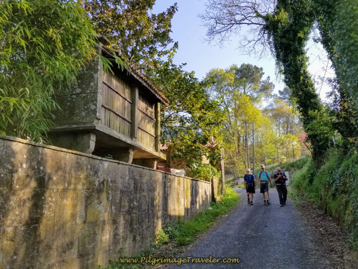 The gentlemen pass an horreo on the Sionlla Abaixo on day eight of the Camino Inglés