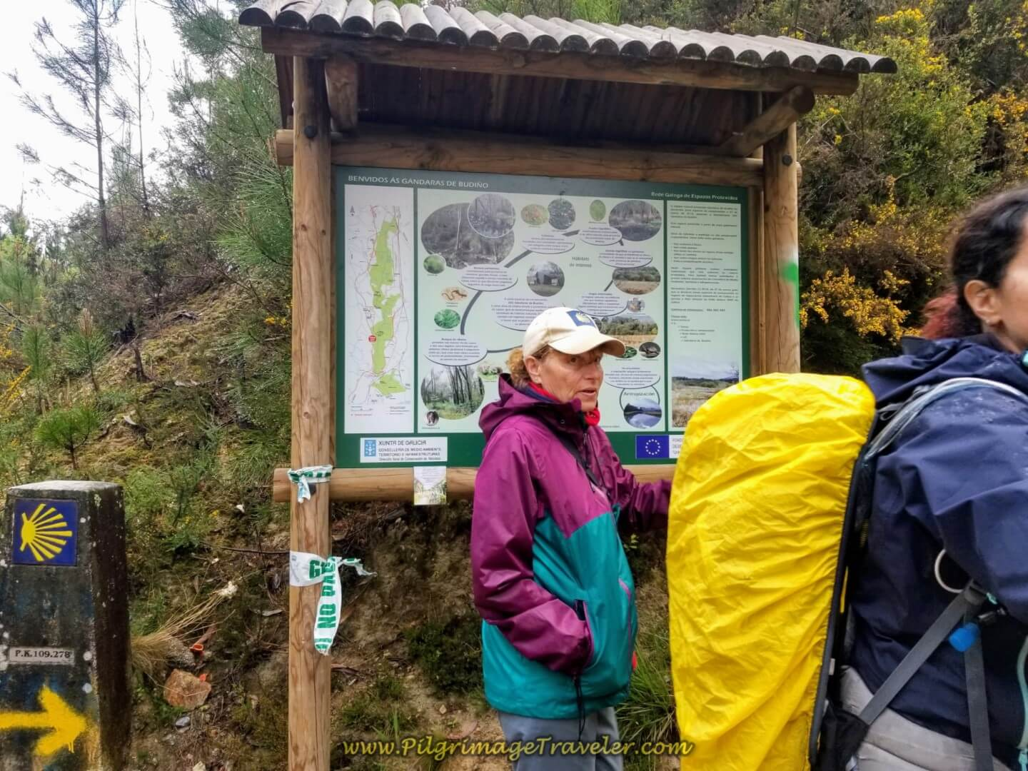 Glyvia and the Information Board at the Turnoff on day twenty on the central route of the Portuguese Camino