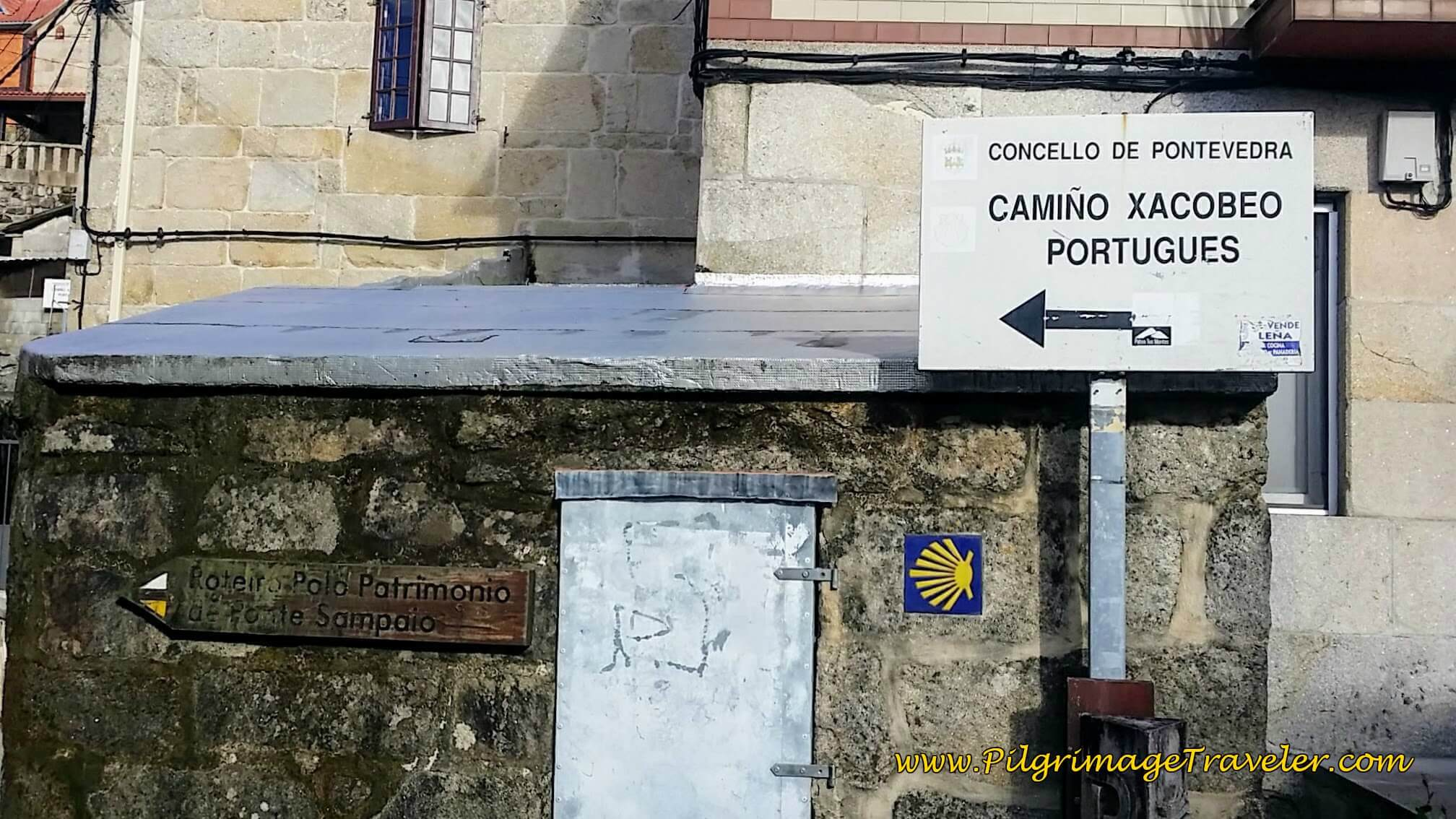 Camiño Xacobeo Portugues Sign -Turn Left Here After Bridge in Arcade, day twenty-two on the Camino Portugués