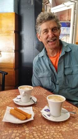 Disheveled Hubby Smiles Over His Café Con Leche and Churros