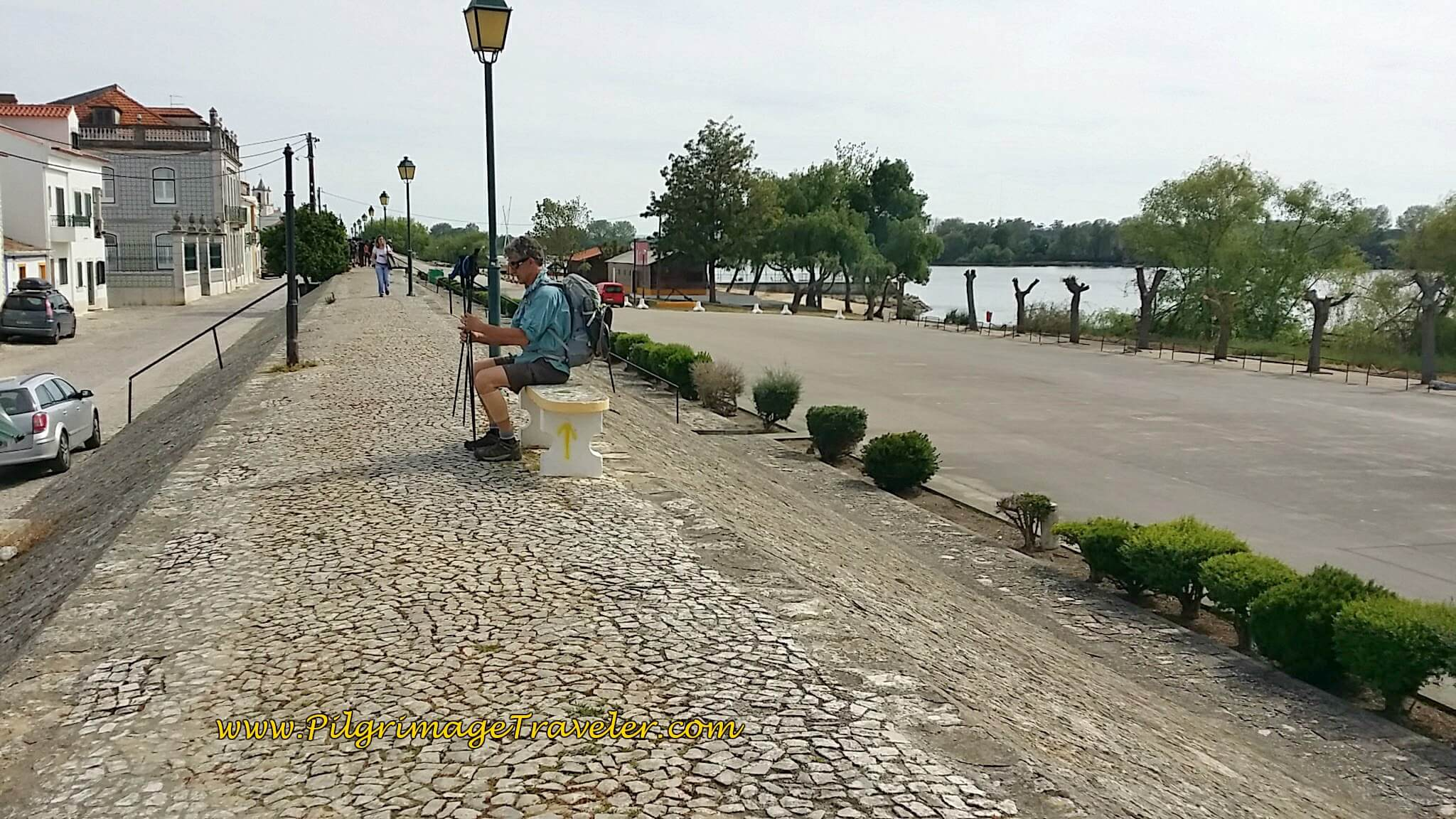 Rich Sitting on Bench on the Camino Along the Dike in Valada, Portugal