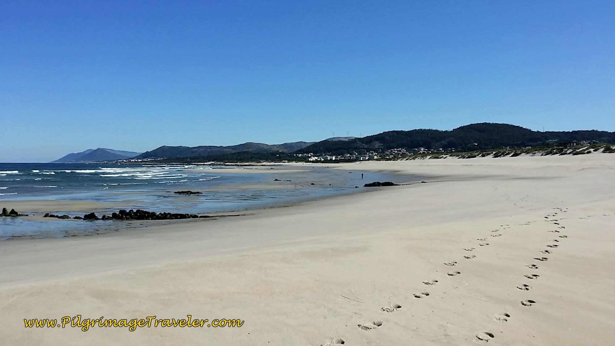 Footprints on the Praia de Arda on day eighteen of the Portuguese Way on the Senda Litoral