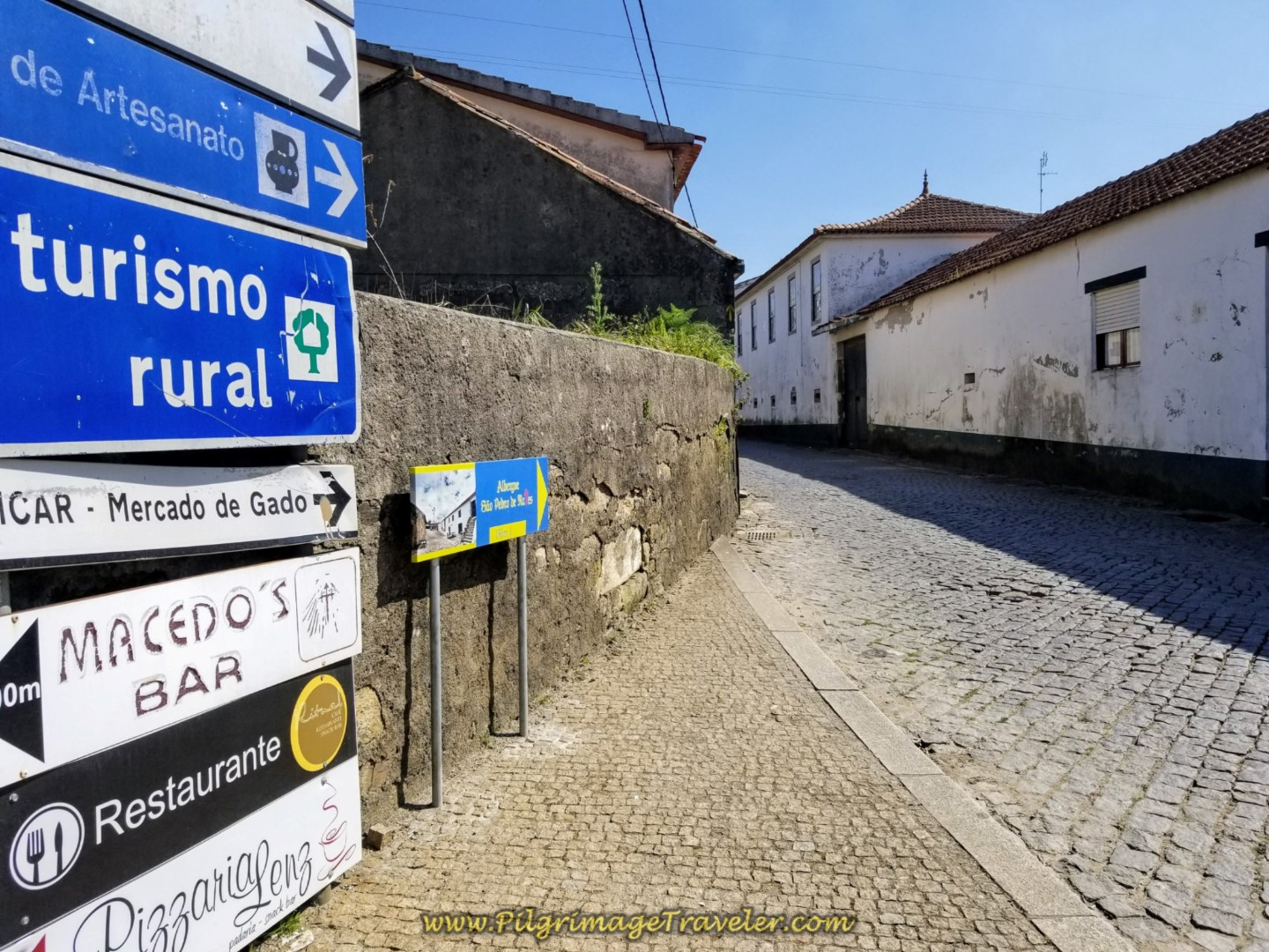 Sign for the Albergue de Peregrinos de São Pedro de Rates on day sixteen on the Central Route of the Camino Portugués