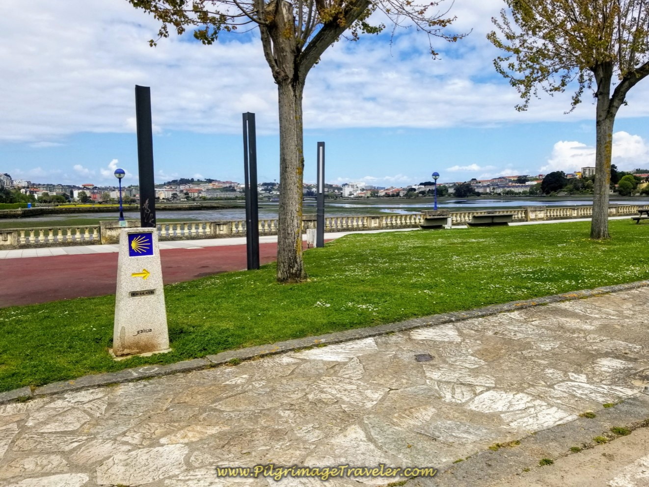 Kilometer Marker 64.4 by the River on day one of the La Coruña Arm of the Camino Inglés