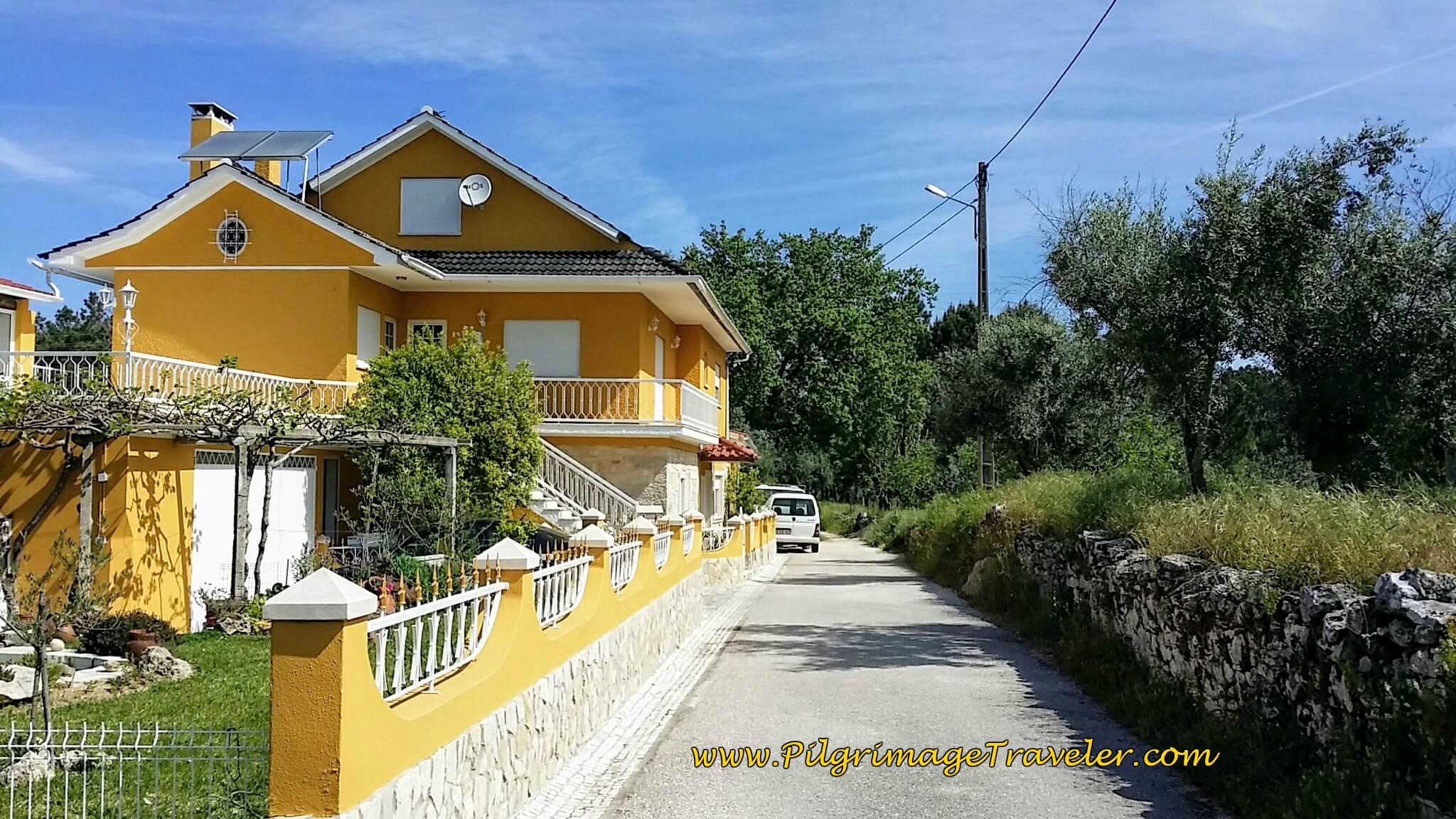 Paved Road Ends at Bright Yellow House in Ansião on the Portuguese Way