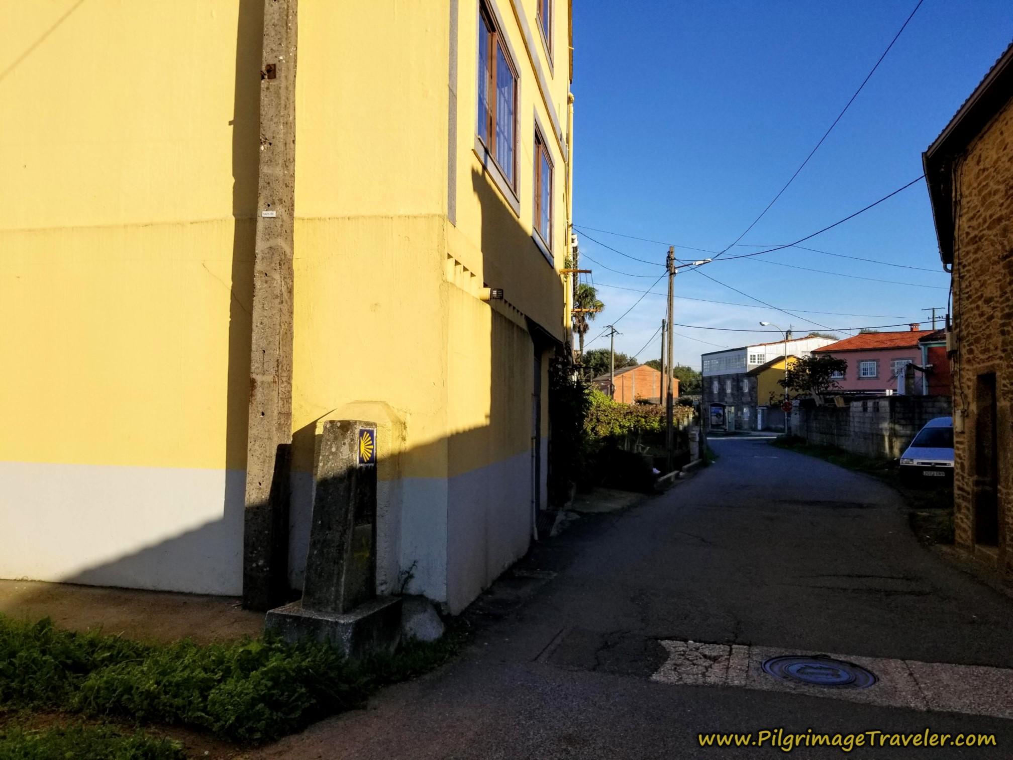 Continue on the Rúa de Angrois