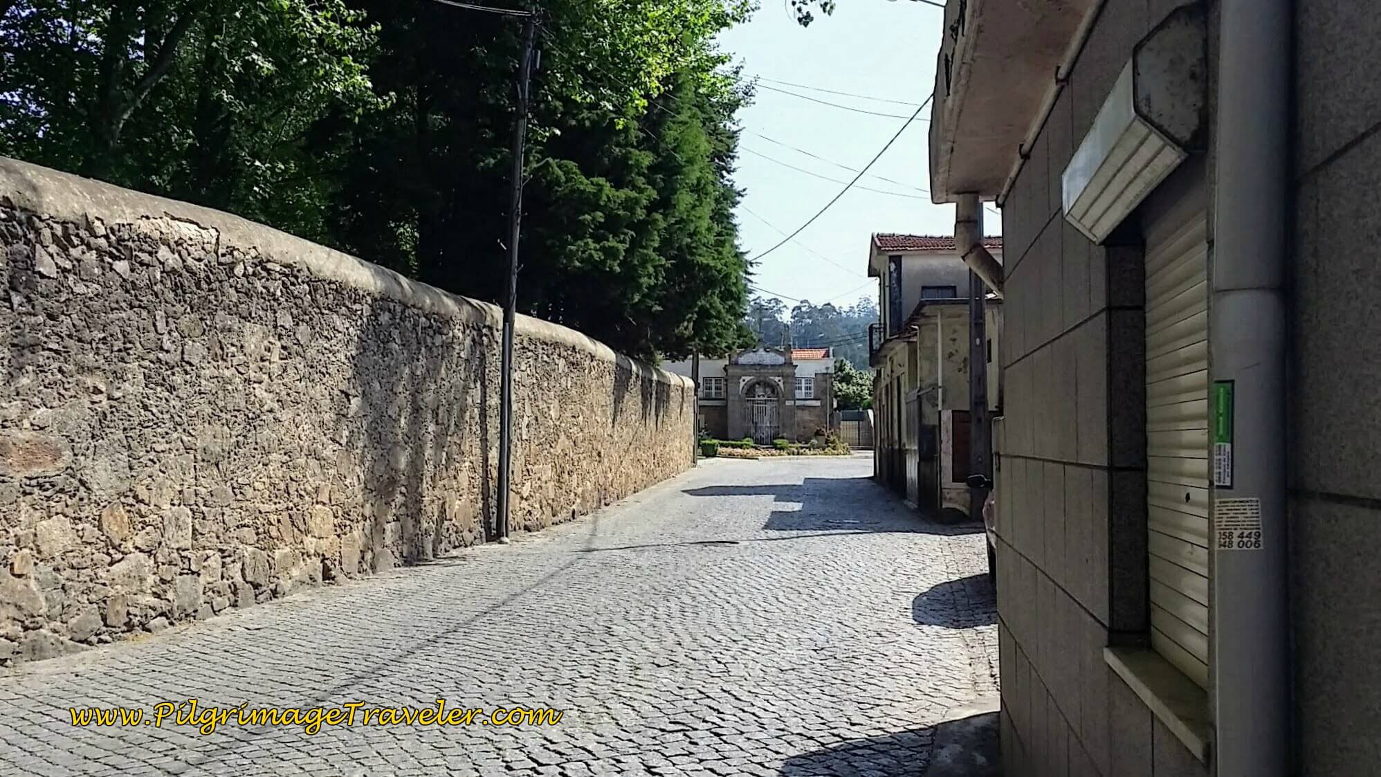 A Look Back at Municiple Stadium of Grijó on the Rua Cardoso Pinto on day fourteen of the Portuguese Way