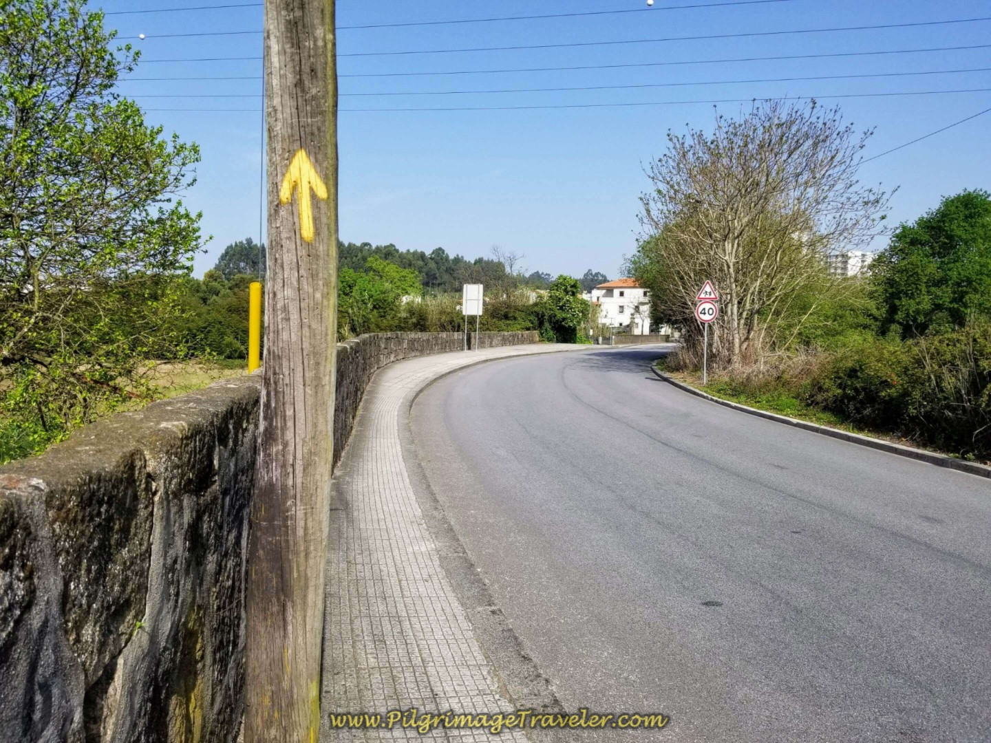 Continue on the Rua Ponte de Moreira on day fifteen on the Central Route of the Camino Portugués