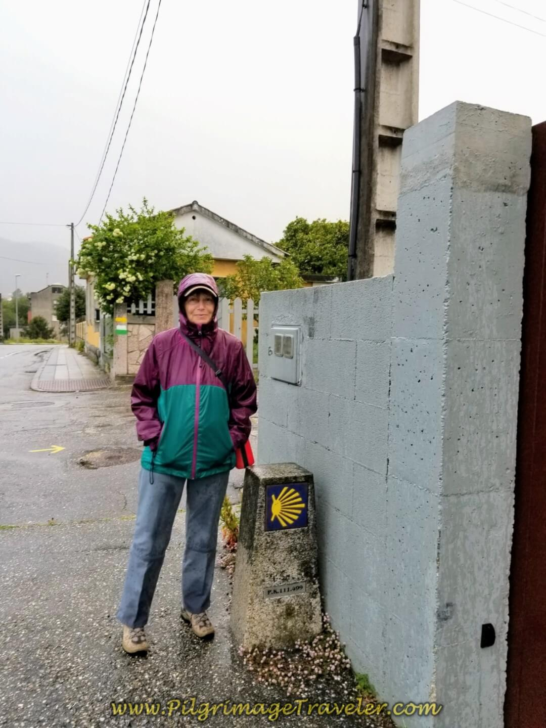 Glyvia at 111.5 Kilometer Waymark in the town of Virxe do Caminño on day twenty on the central route of the Portuguese Camino