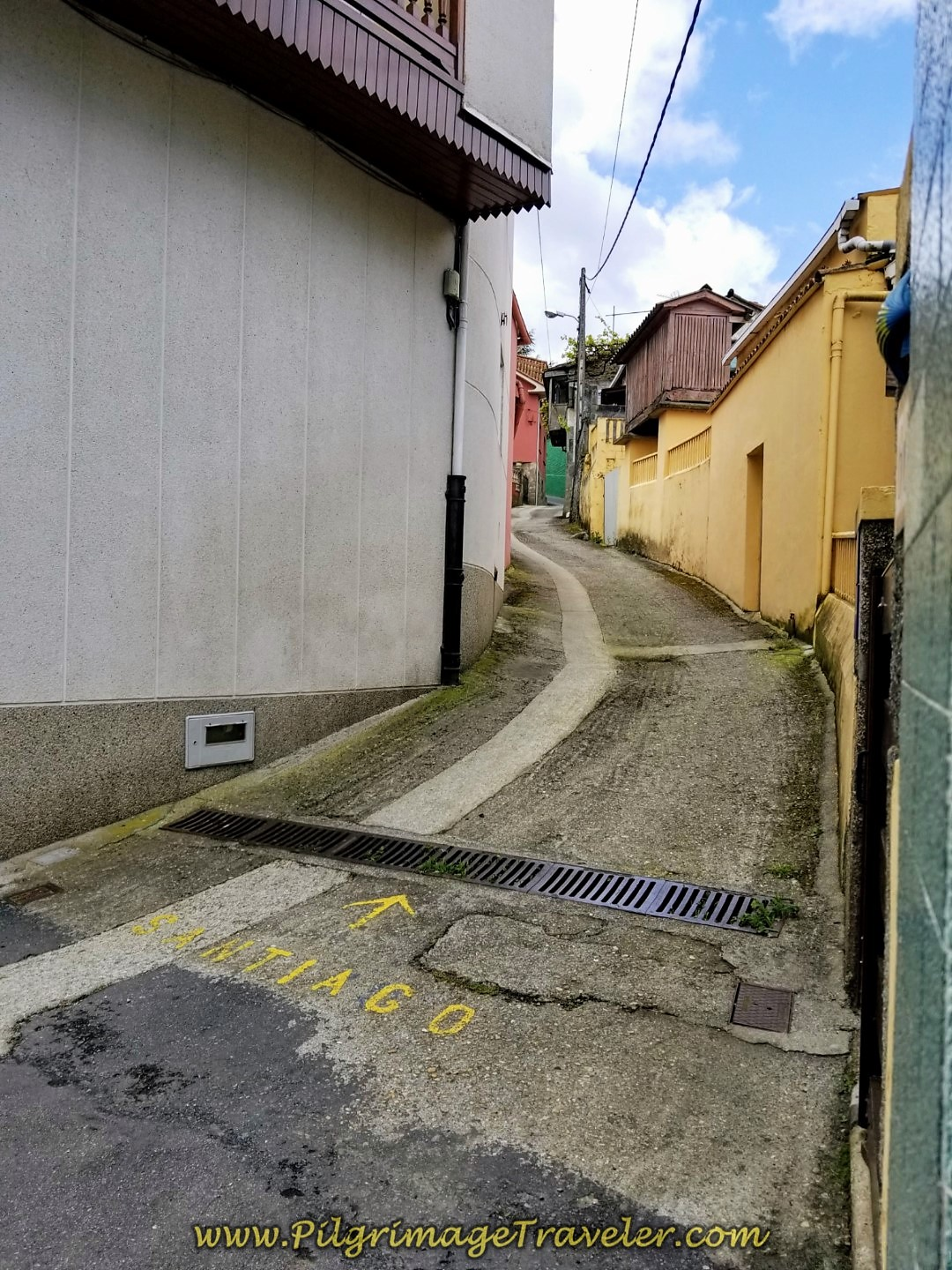 Turn Right Into Camiño Pedridas Alleyway on day three of the Camino Inglés