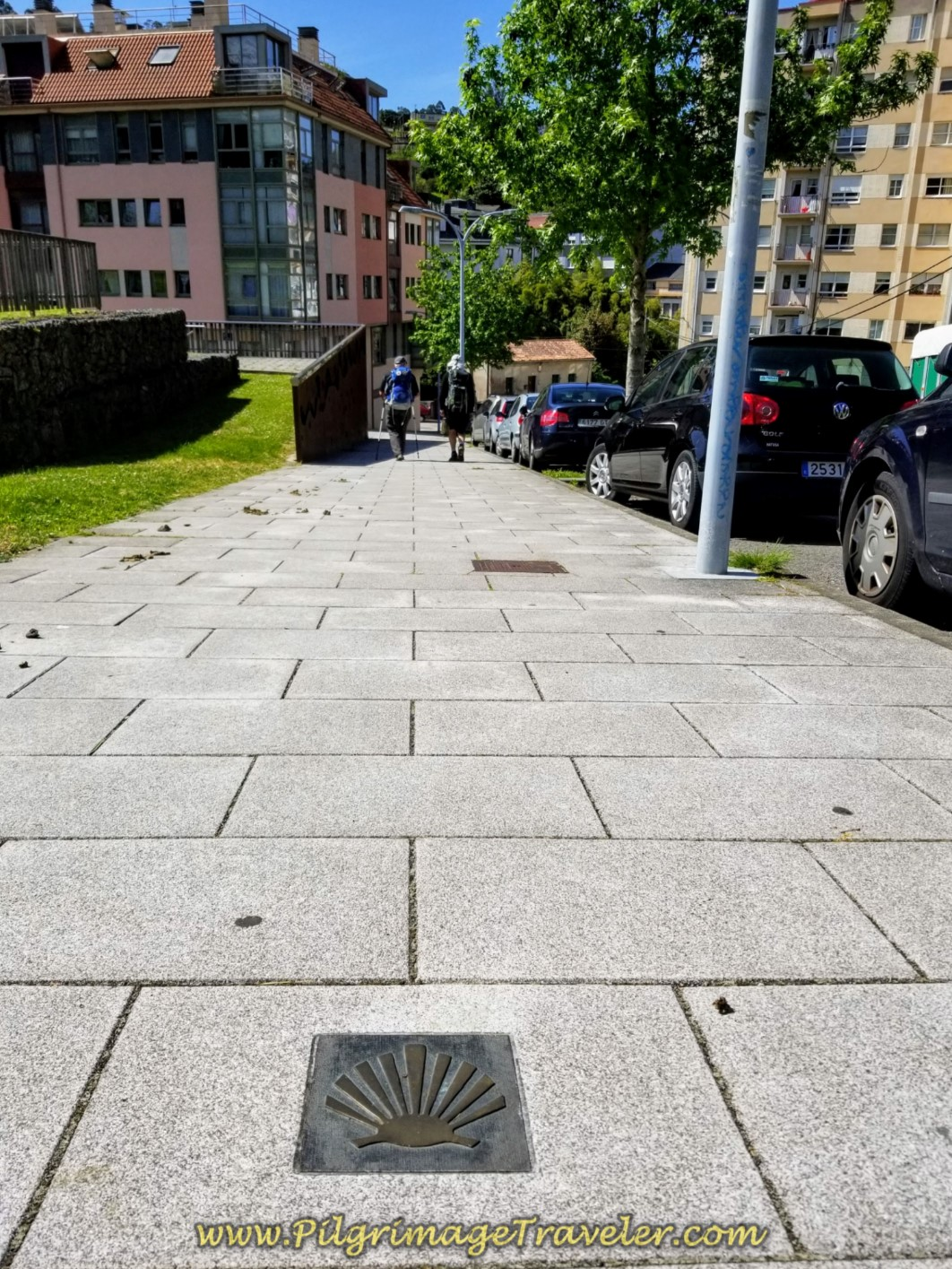 Embedded Waymark on the Sidewalk Along the Rúa Rollo on day five of the Camino Inglés