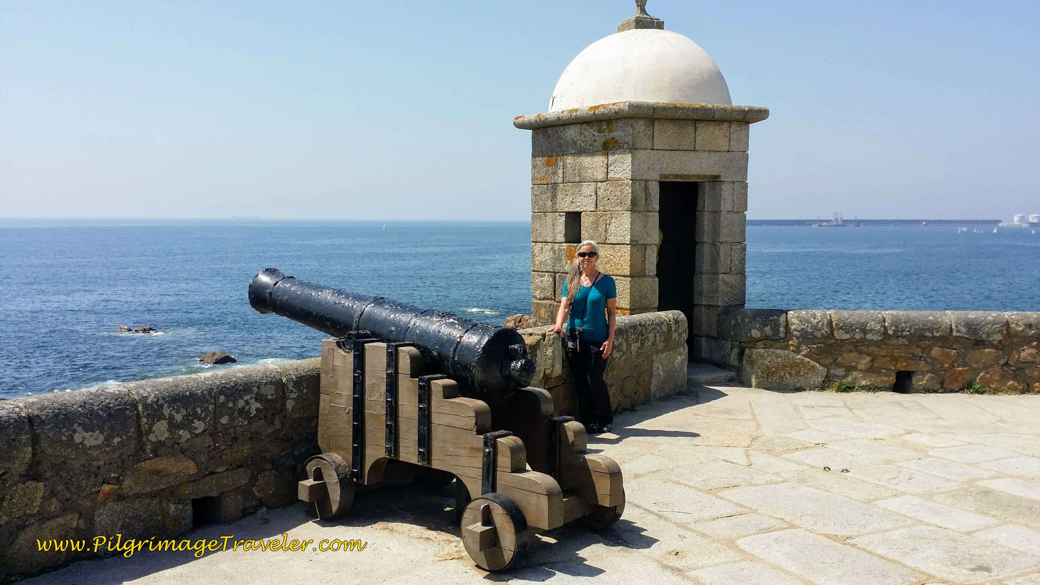 Elle with a Cannon by a Sentry Tower of the Castelo do Queijo in Porto, Portugal