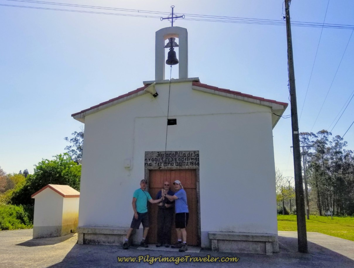 Rich, Steve and Rob Ringing the Bell at the Capela de San Roque in As Travesas on day six of the Camino Inglés