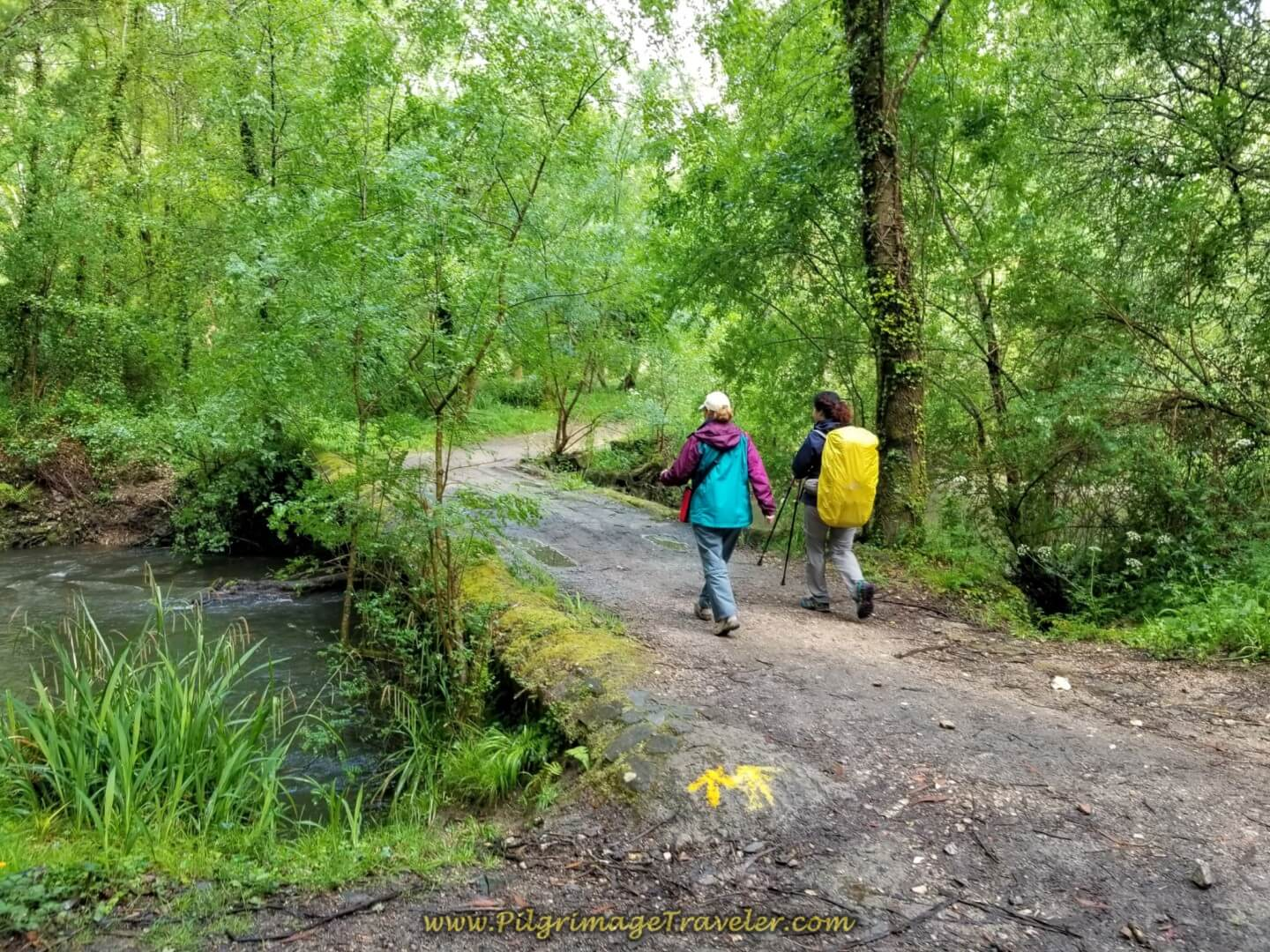 Glyvia and Miriam Cross the Puente de Baranco on day twenty on the central route of the Portuguese Camino