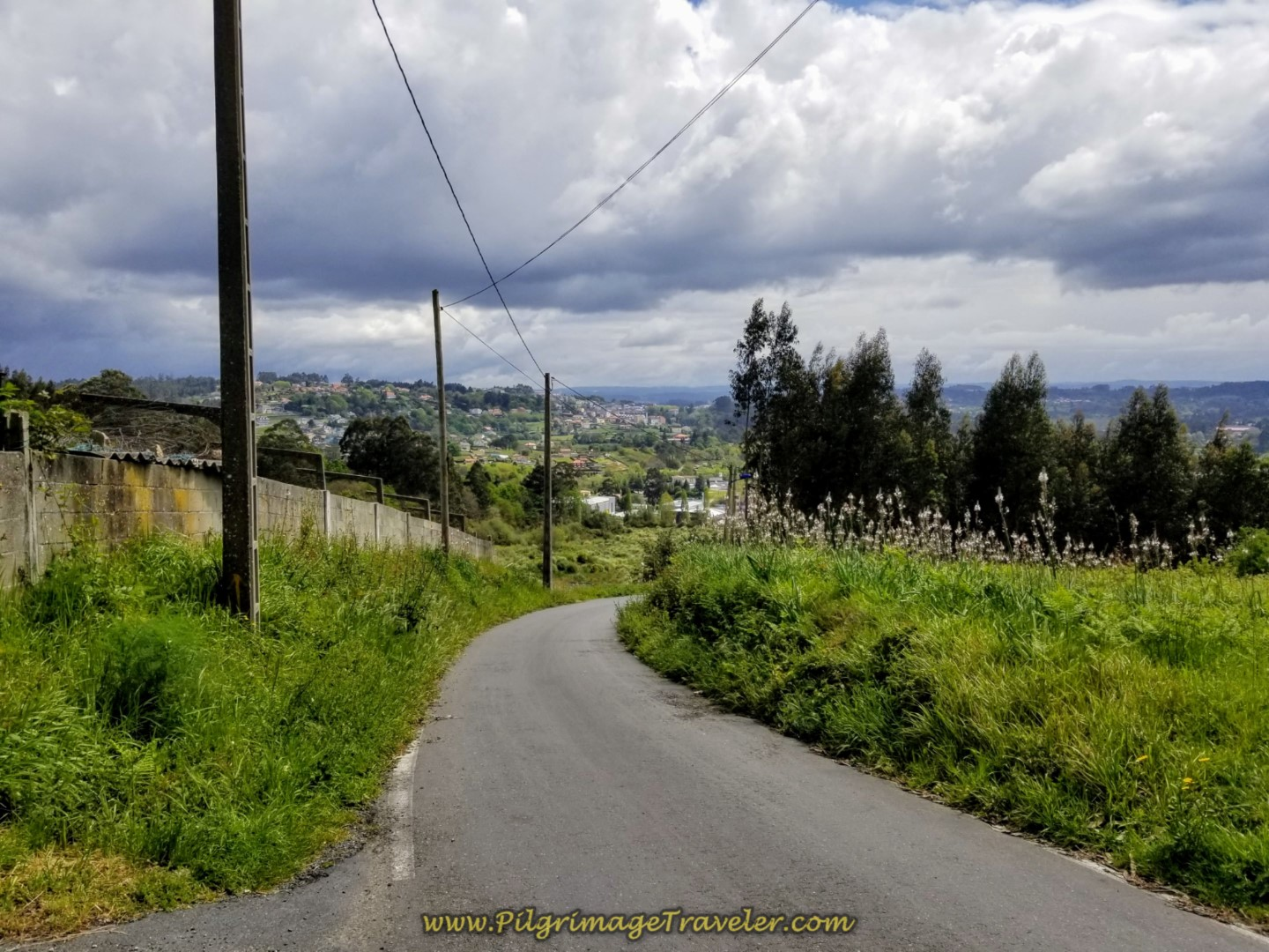 Continue Downhill on Rural Road on day one of the La Coruña Arm of the Camino Inglés