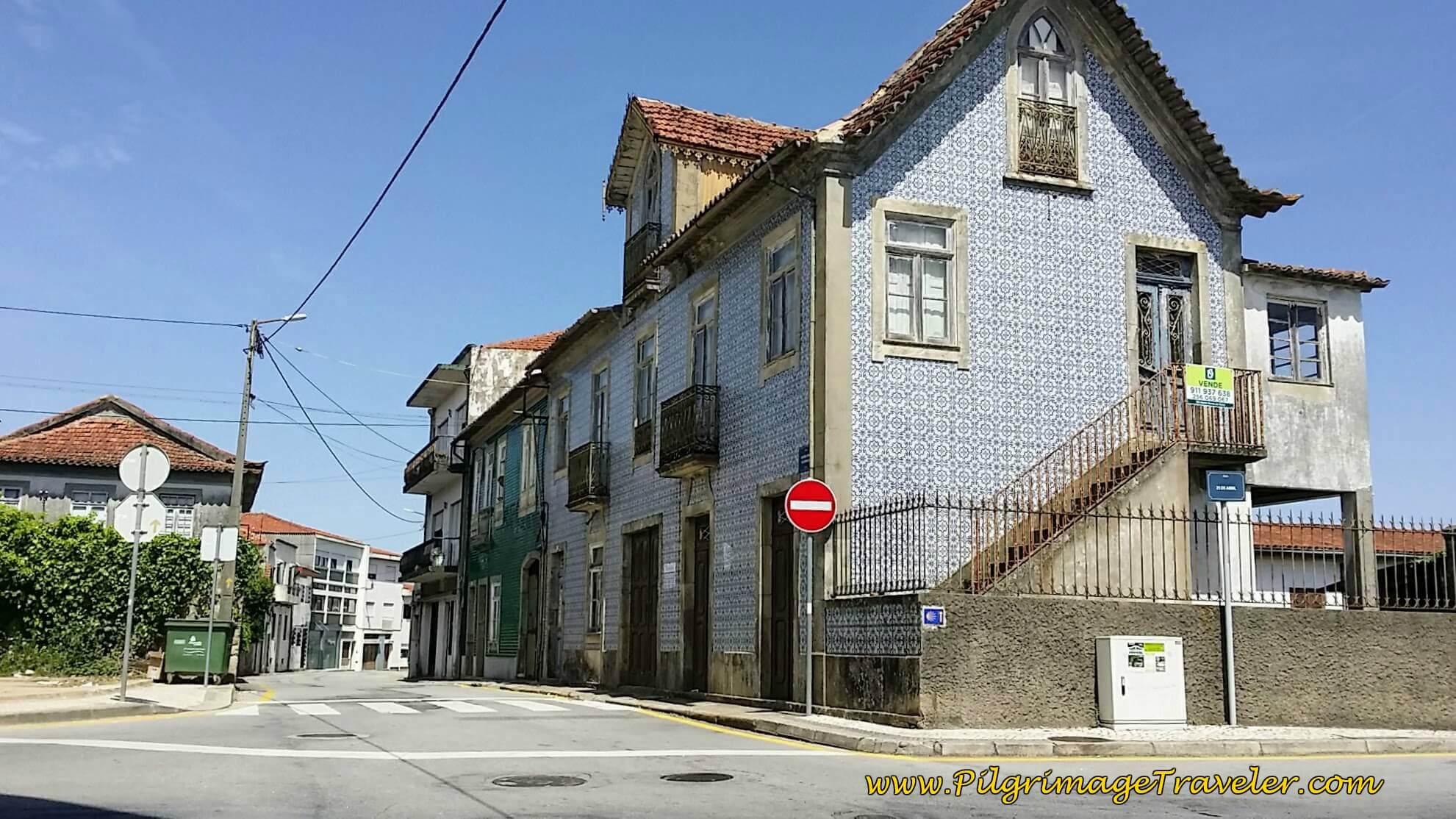 Straight on at thsi Azulejo-tiled  Building on Rua Antonio Pinto de Carvalho on day thirteen of the Camino Portugués