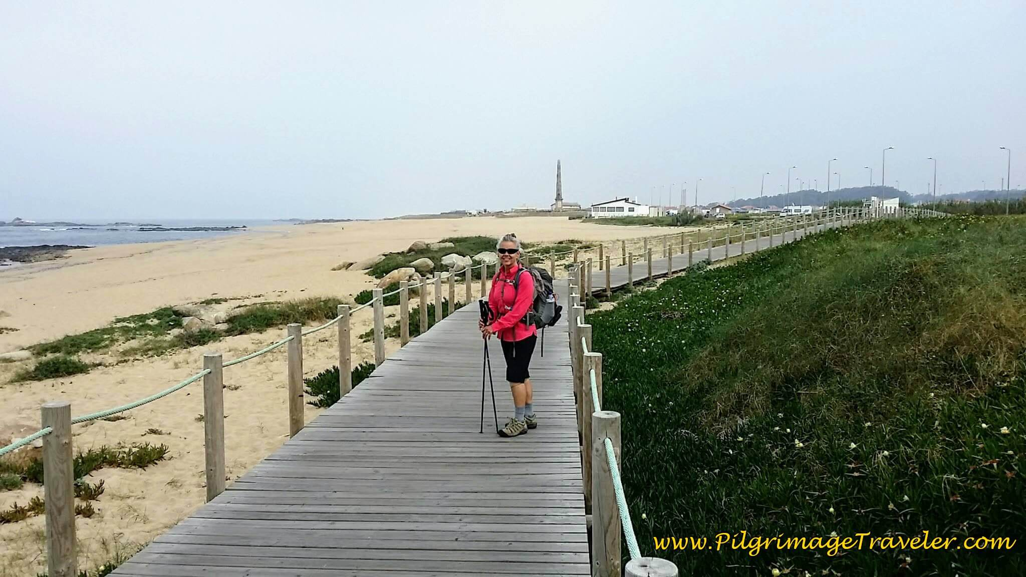 Elle on Praia da Memória Boardwalk on day fifteen of the Camino Portugués on the Senda Litoral