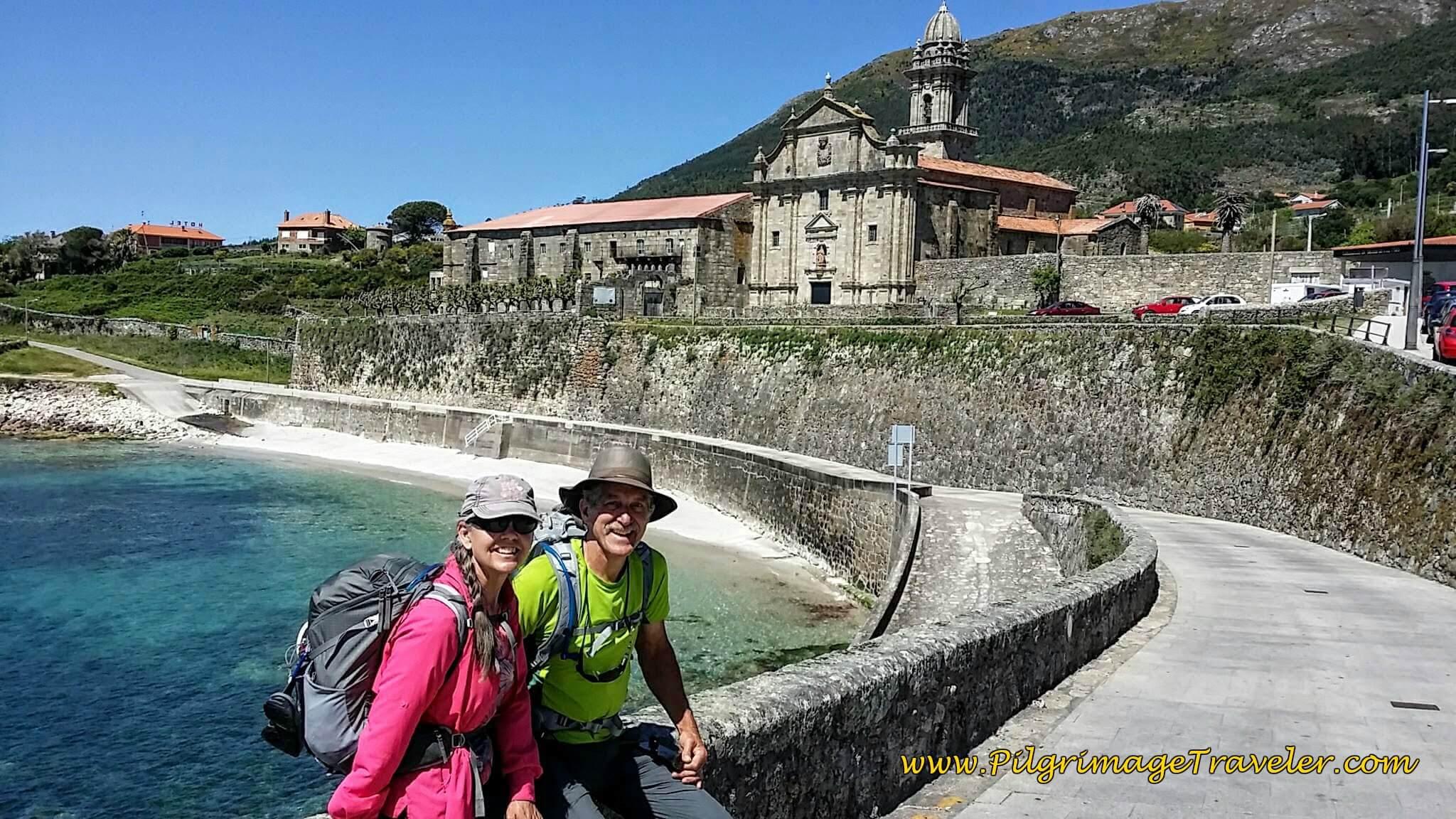 Elle and Rich at the Mosteiro de Santa María de Oia, Spain on Day Nineteen of the Camino Portugués
