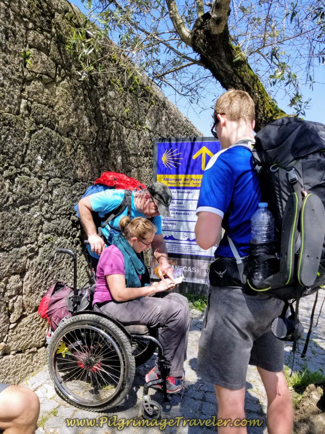 Pedro, Magdalena and Magnus conferring with the map in Pedra Furada on day sixteen on the Central Route of the Portuguese Way