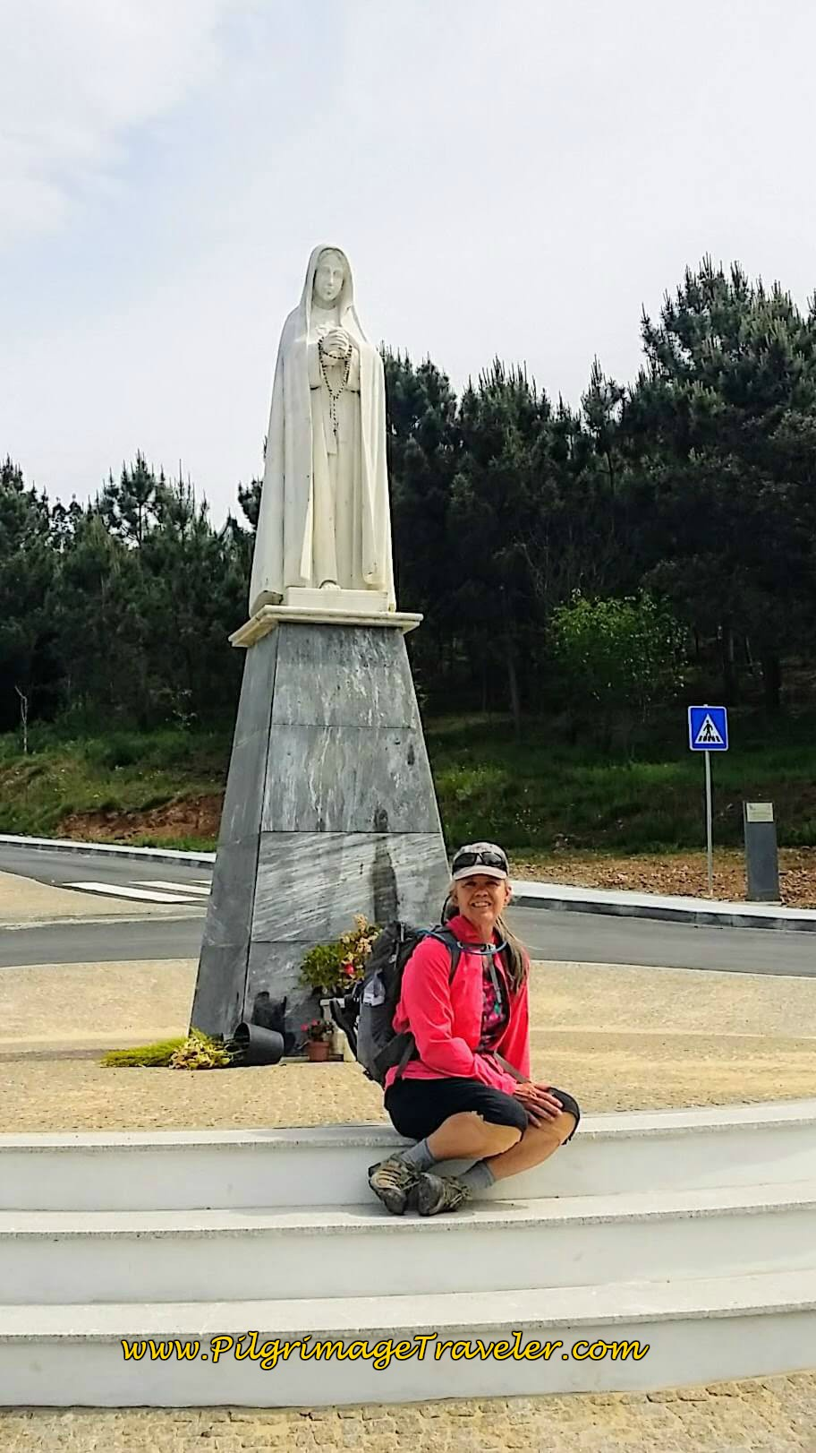 Elle at the Statue, Nossa Senhora do Socorro on day twelve of the Camino Portugués