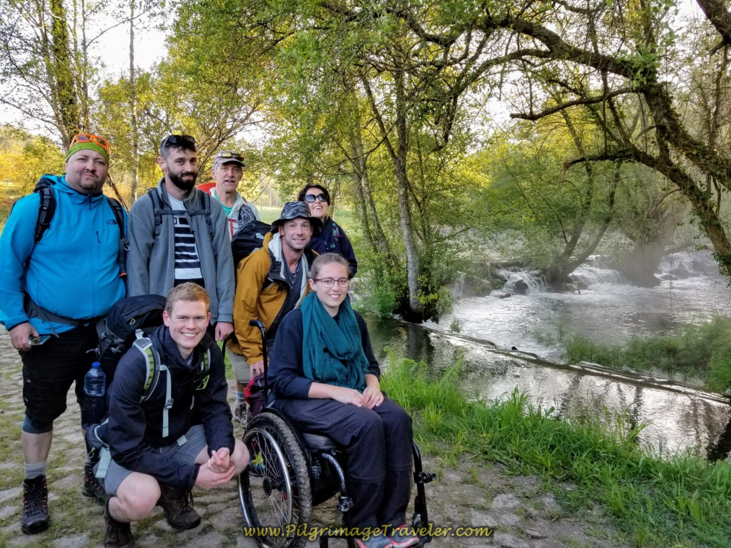 The Team at a Waterfall on the Rio Coura on day nineteen on the Central Route of the Portuguese Camino