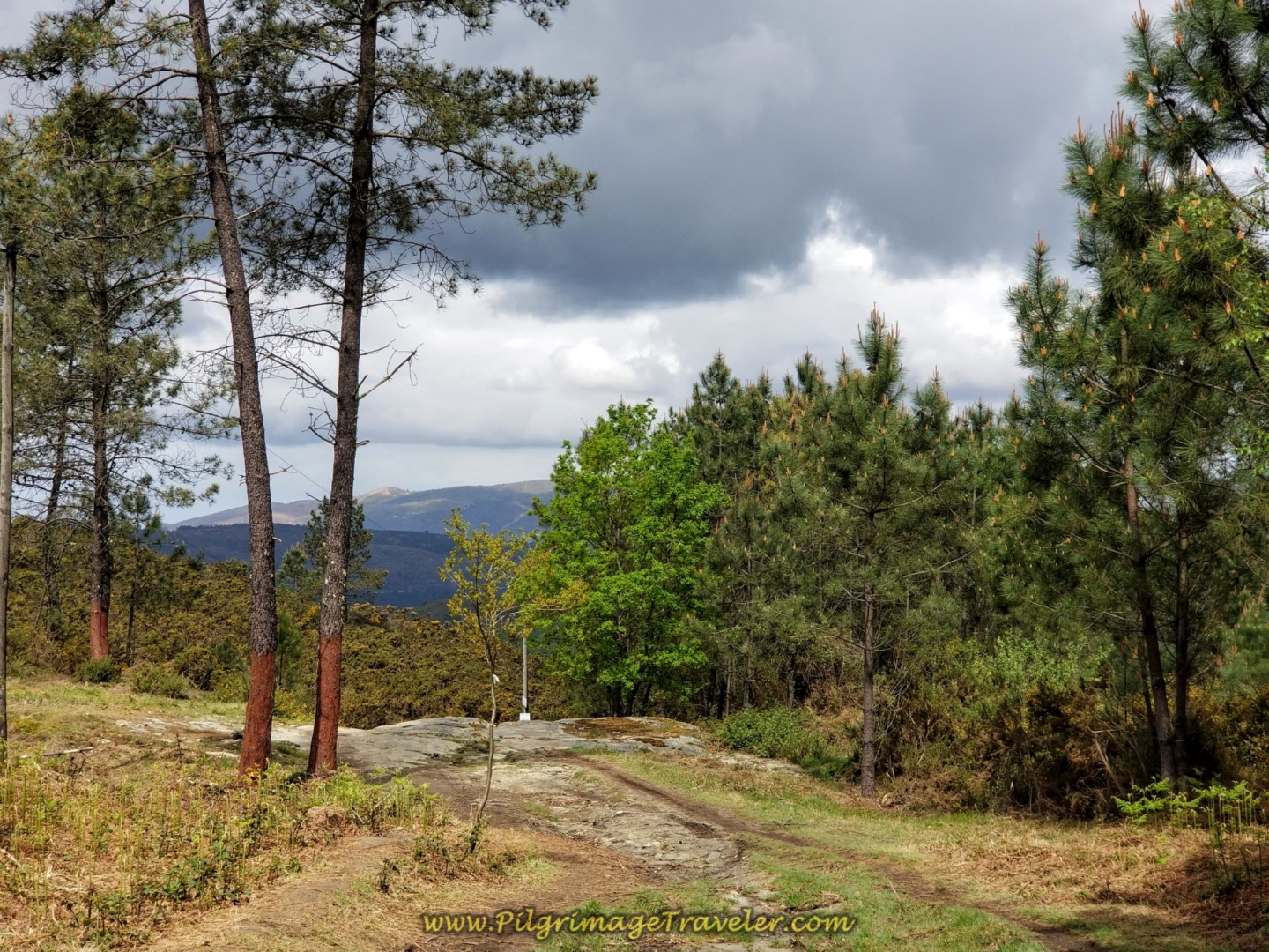 Weather Threatens on the Way Down the Mountain on day eighteen on the Central Route of the Portuguese Camino