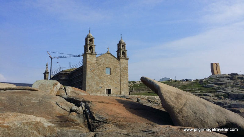 Nosa Señora da Barca Church and the Pedra da Abalar in Muxia, Spain