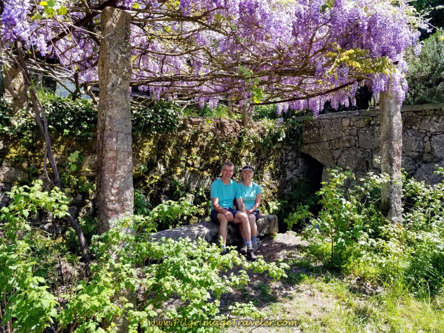 Rich and Elle Rest in the Wisteria Arbor at the Quinta da Portela Facha