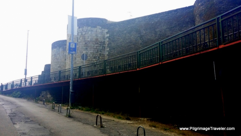 The Old Ramparts Loom Above as you enter medieval Lugo, Spain
