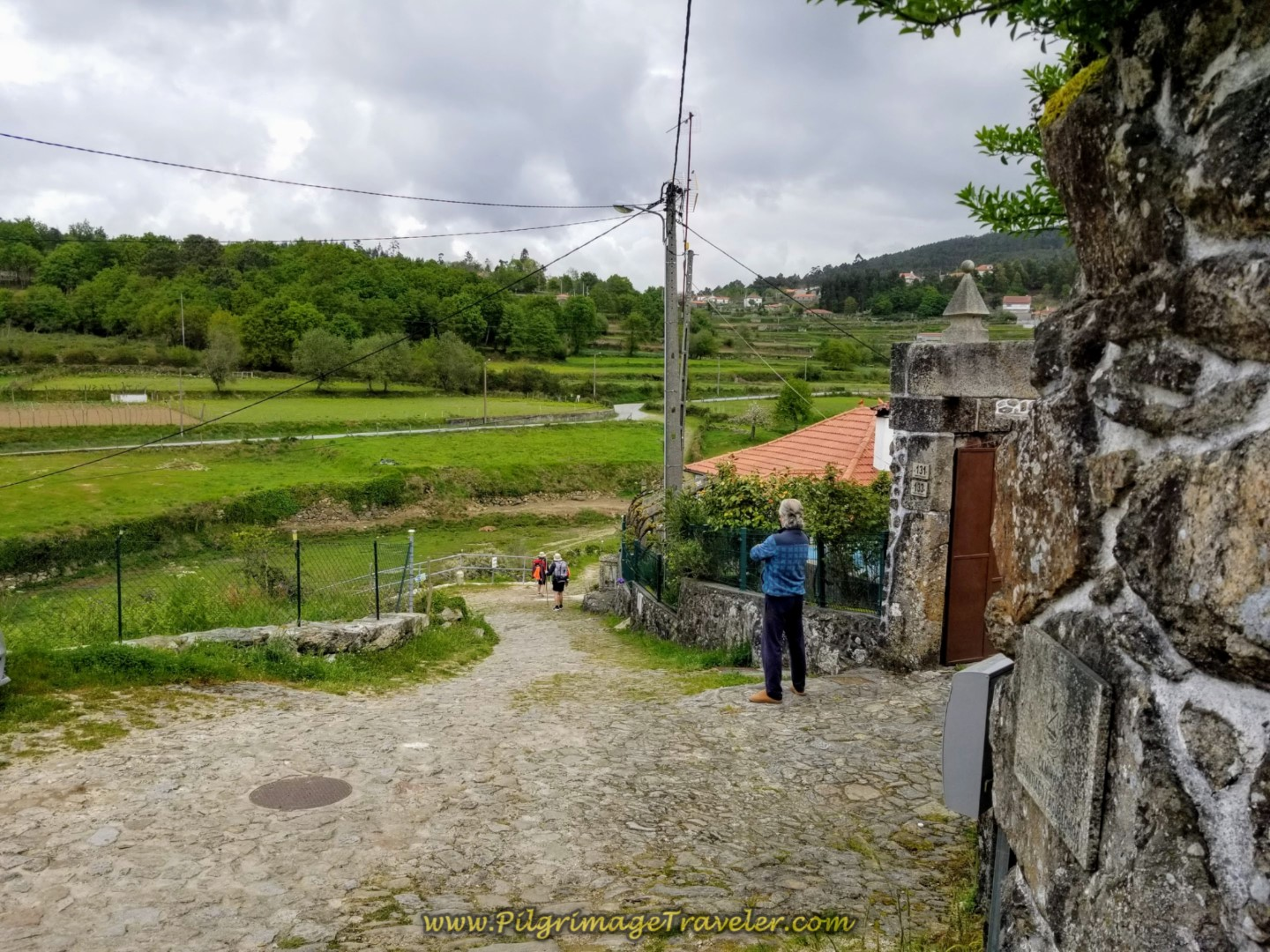 Local Entertains Himself Watching Peregrinos on day eighteen on the Central Route of the Portuguese Camino