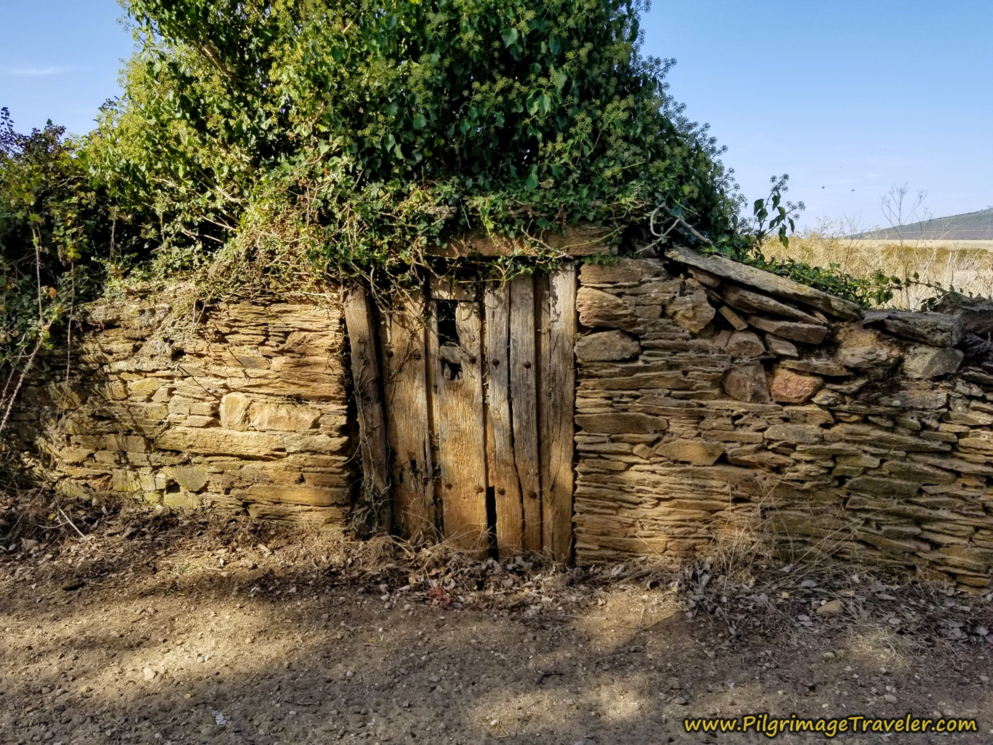 Walled Entrance to Town with Old Door on the Camino Sanabrés from Granja de Moreruela to Tábara