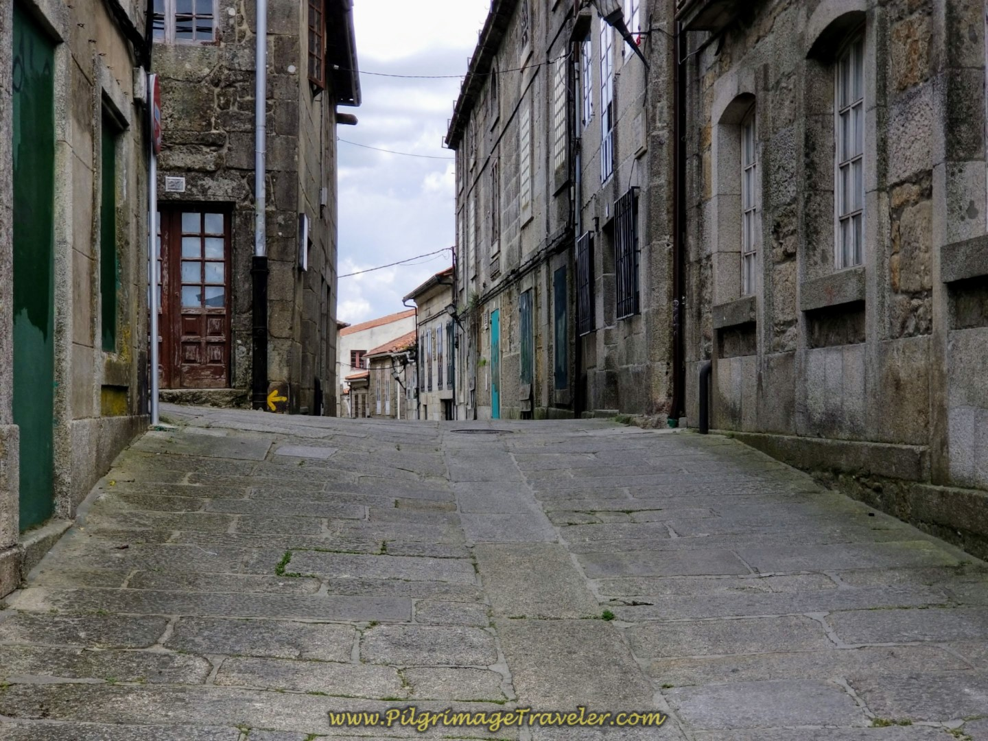 Walking Up the Rúa Piñeiro in Tui, toward the cathedral on day nineteen on the Central Route of the Portuguese Camino