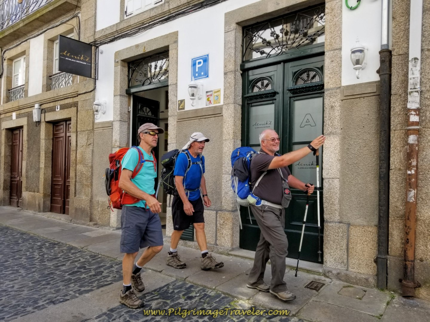 Steve Points the Way to the Cathedral on the Rúa da Porta da Pena on day eight of the English Way