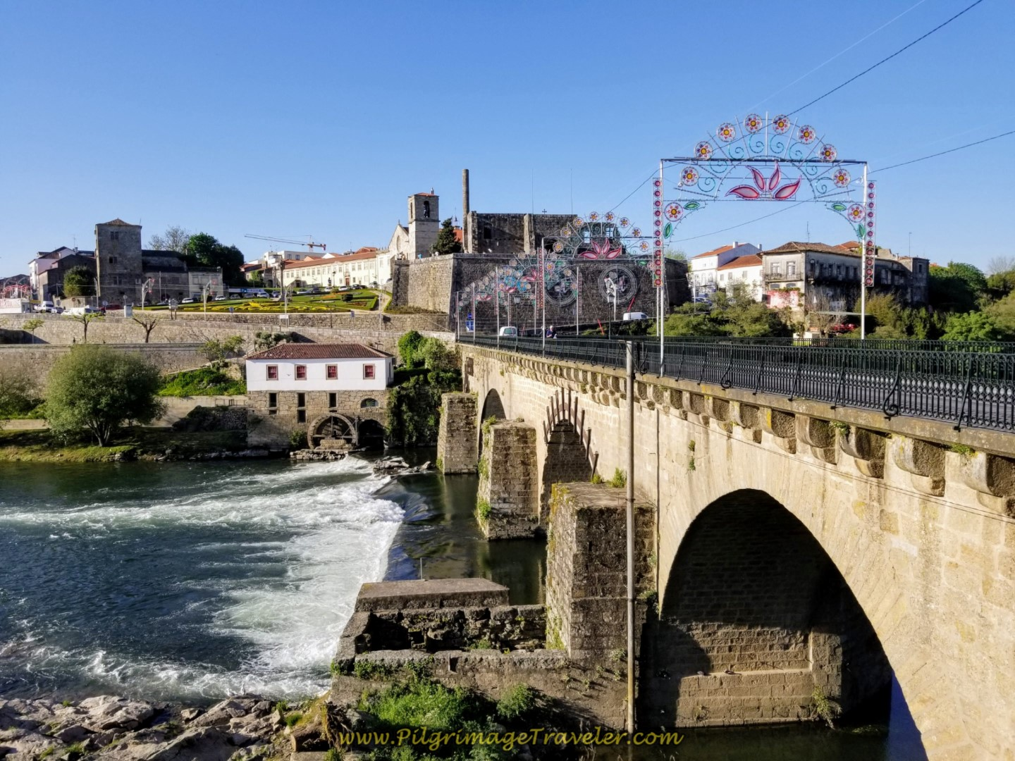 Crossing the Cádavo River on the 14th Century Medieval Bridge into Barcelos, connecting it with Barcelinhos to the south