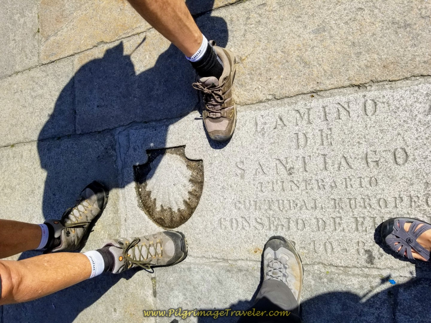 Stepping on the Final Waymark in the Praza do Obradoiro on day eight of the English Way