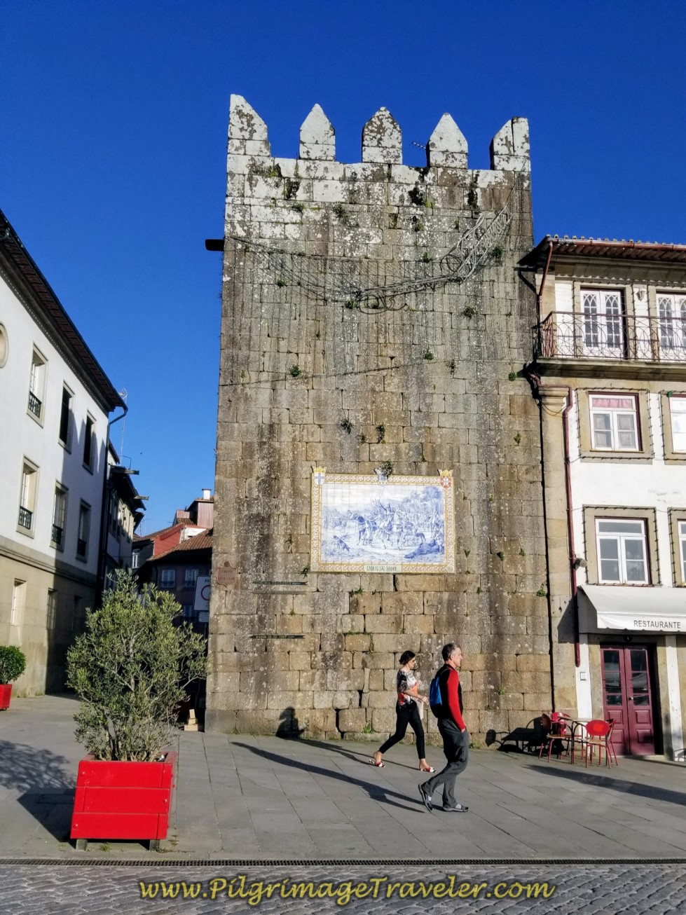Rich Walking by the Torre de São Paulo in Ponte de Lima on day seventeen on the Central Route of the Camino Portugués
