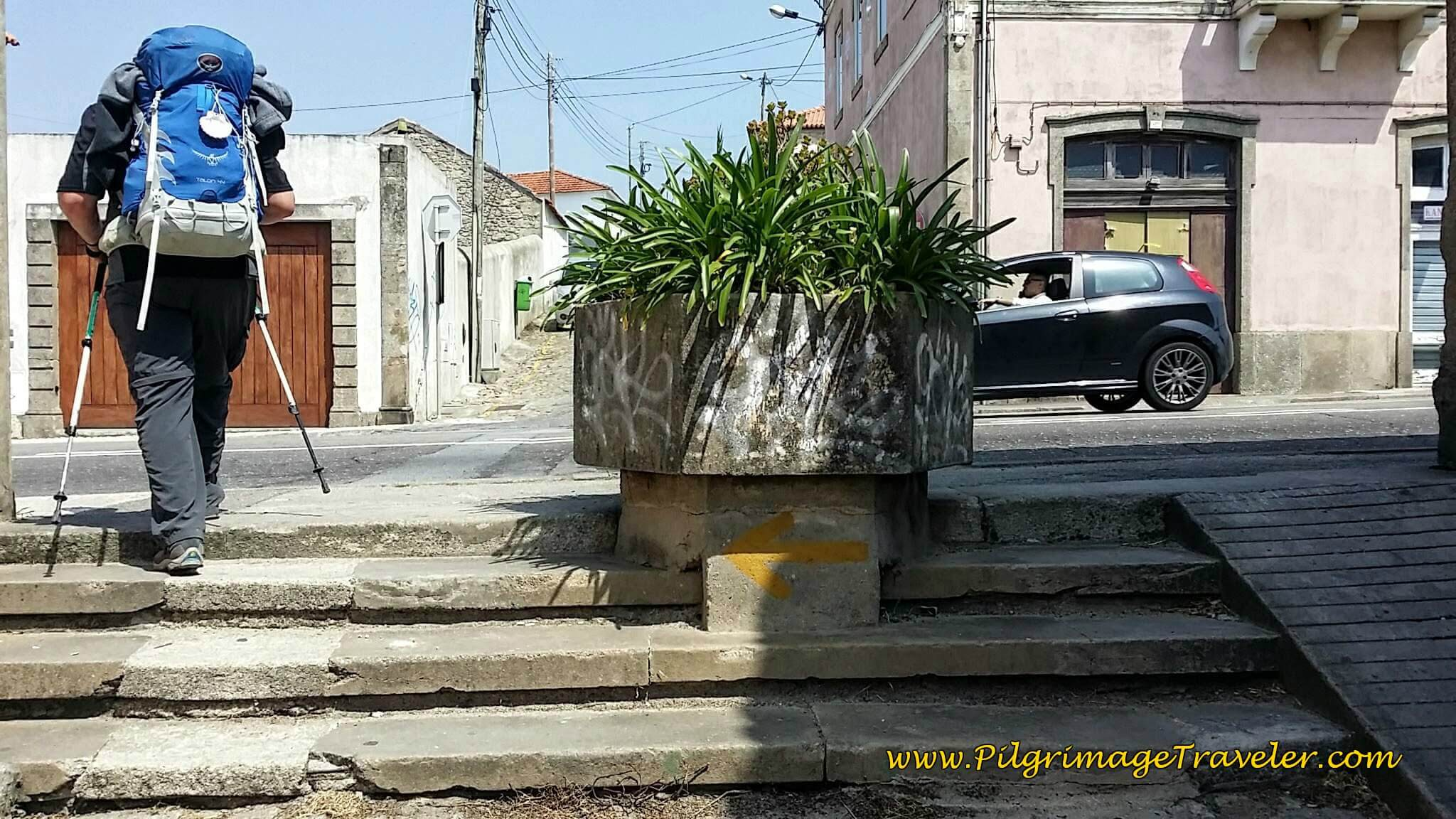 Turn Left at Top of Stairs Onto N13 into Vila do Conde on day fifteen of the Camino Portugués on the Senda Litoral